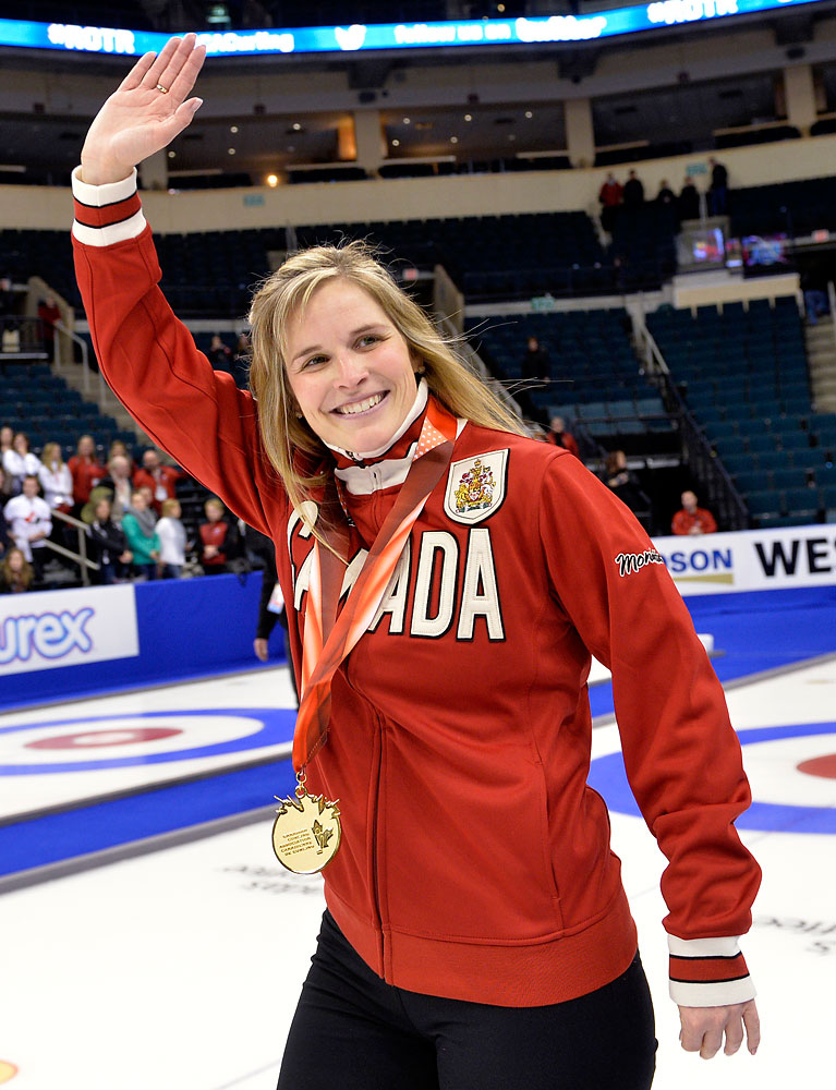 Skip Jennifer Jones waves to the crowd after defeating Team Middaugh during the women's final at the Roar of the Rings Canadian Olympic Curling Trials in Winnipeg, Dec. 7, 2013.