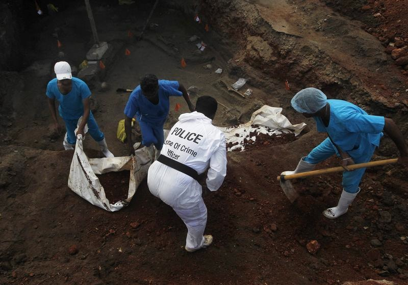 Police officers and doctors dig up skeletons at a newly discovered mass grave in a former war zone in Sri Lanka. The U.S. criticizes the government for moving too slow on probing alleged war crimes.