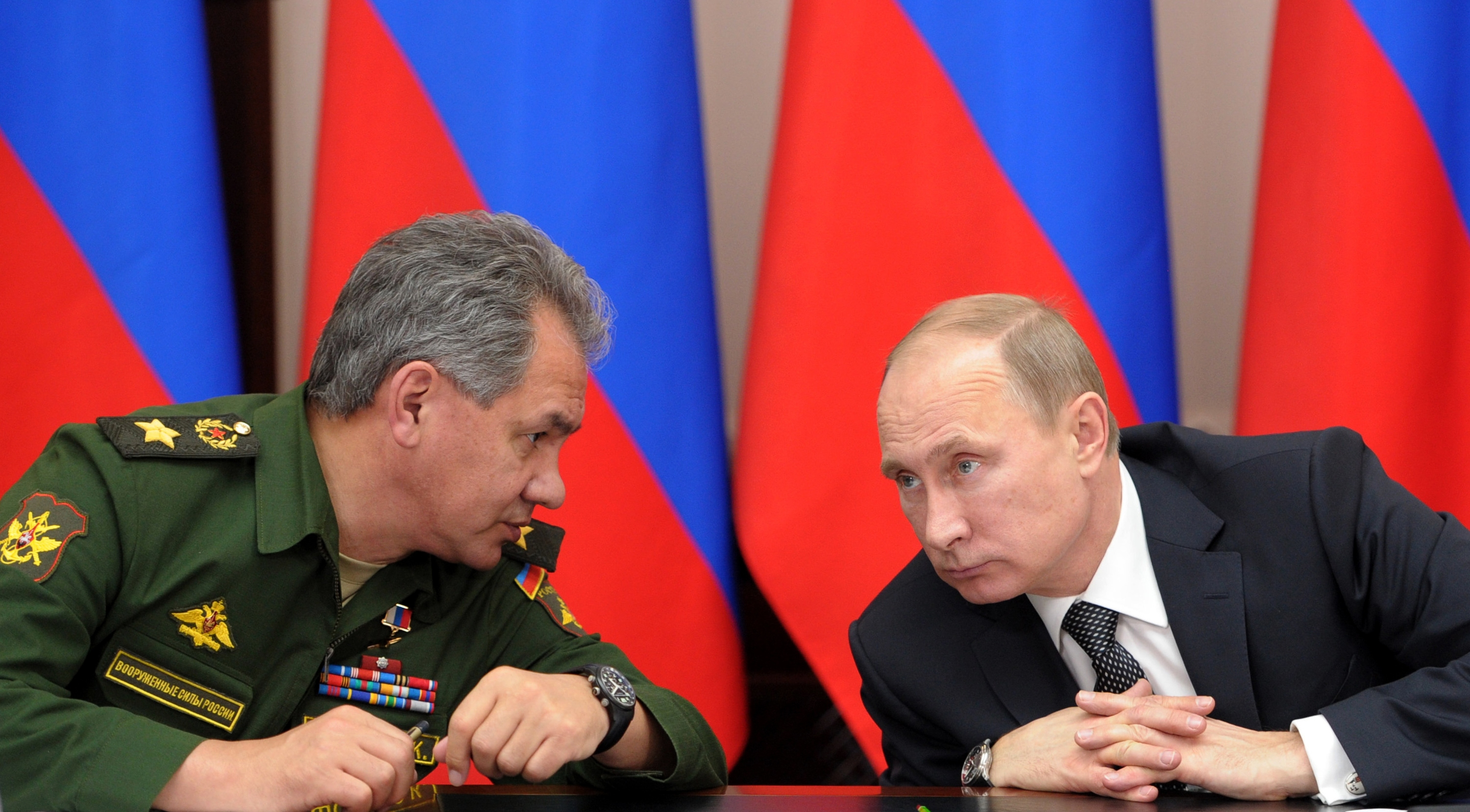 Russian President Vladimir Putin (right) and Defense Minister Sergei Shoigu attend a meeting in Moscow, Russia.