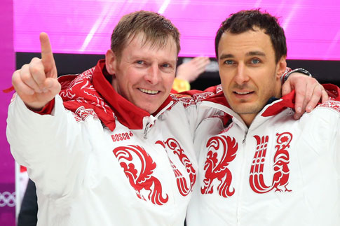 Russian gold medalists Alexander Zubkov, left, and Alexei Voevoda celebrate after winning the two-man bobsleigh event at the Sochi Winter Olympics on Feb. 17, 2014