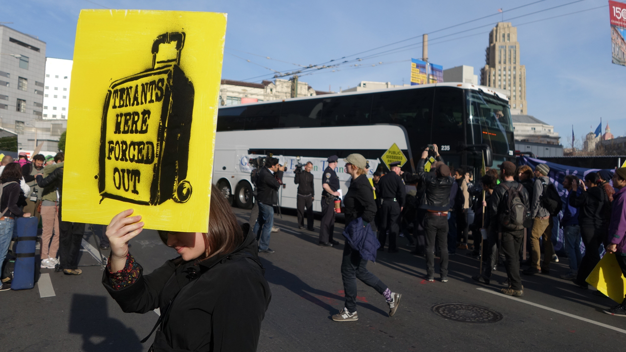 Residents protests rising evictions and rents in San Francisco by blocking two private shuttles transporting tech workers from their homes in San Francisco to their jobs in Silicon Valley on Jan. 21, 2014.