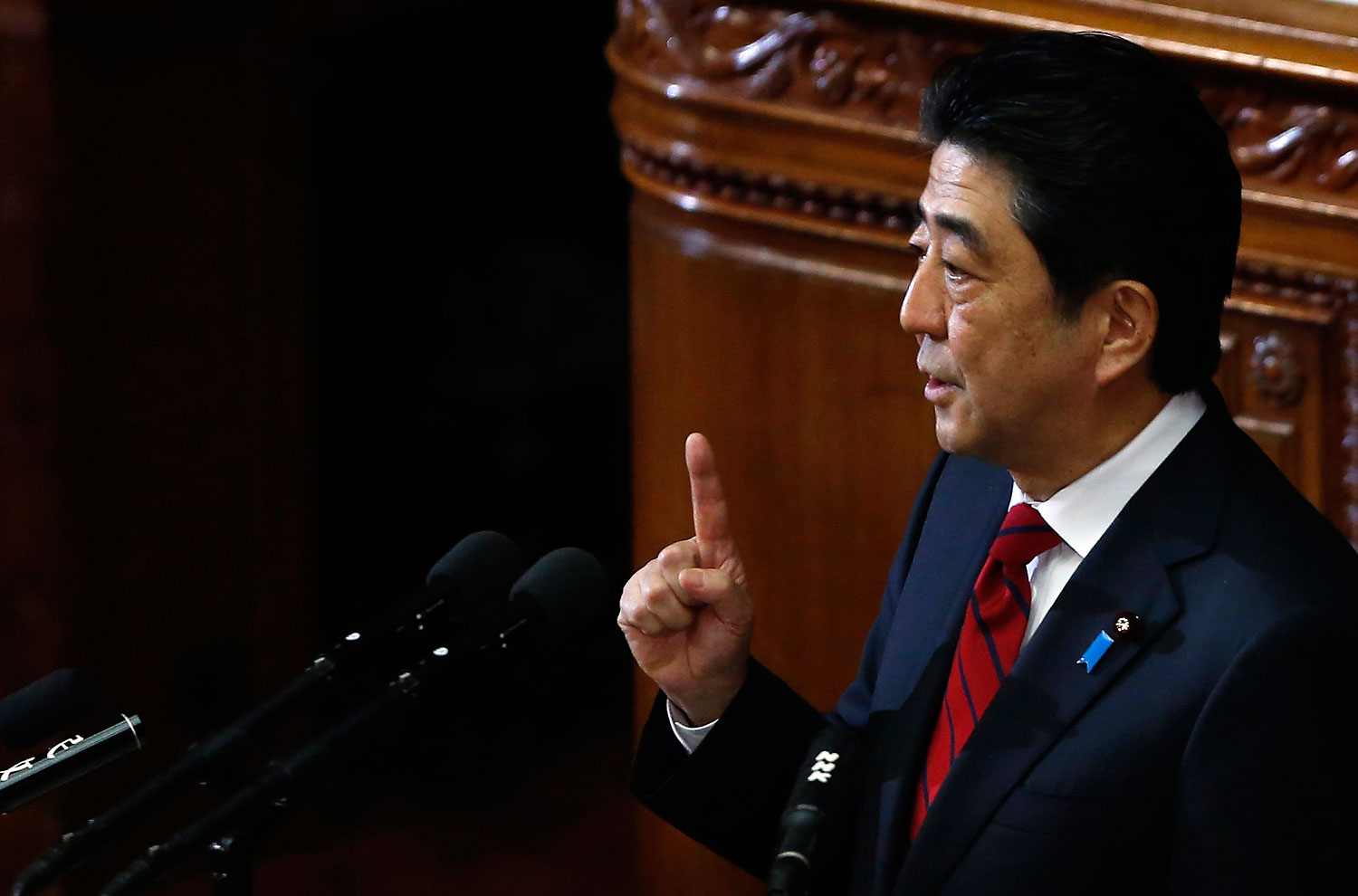 Japan's Prime Minister Shinzo Abe makes a policy speech during the start of an ordinary session at the lower house of parliament in Tokyo on Jan. 24, 2014