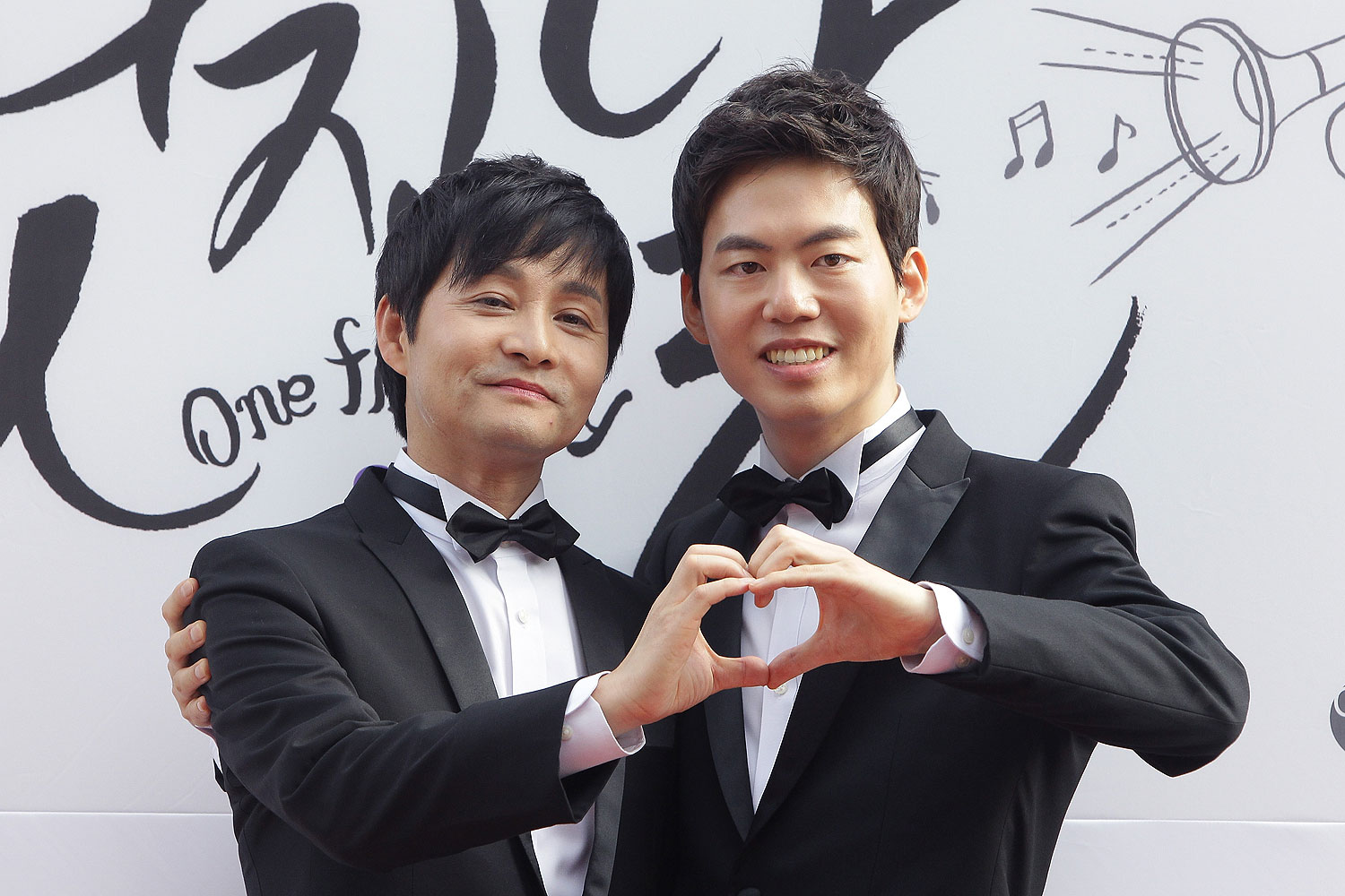 Director Kim Jho Kwang-Soo and Kim Seung-Hwan pose before their wedding in Seoul in Sept. 2013