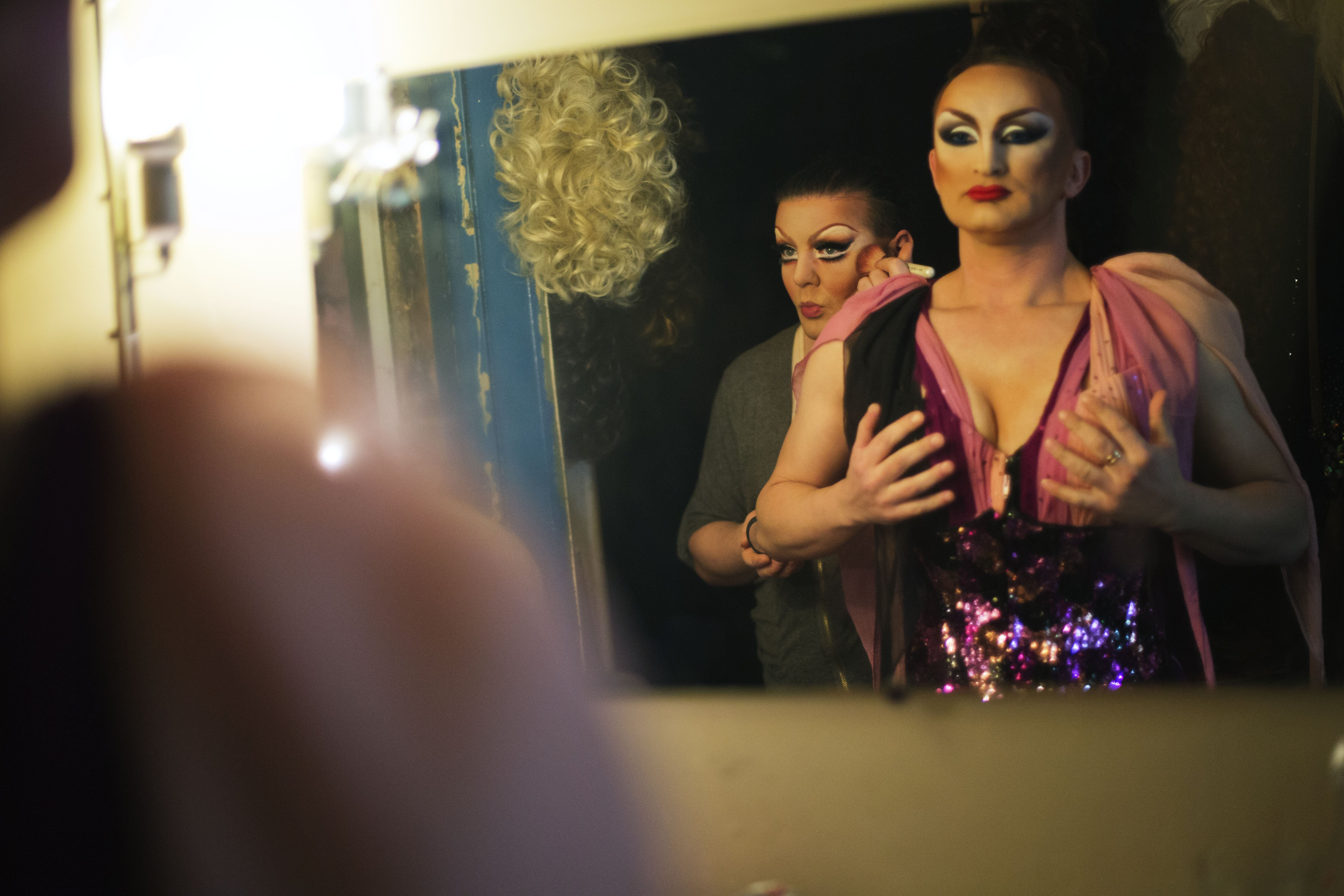 Performers Penelopa, right, and Veranda, left, get ready backstage before a performance at the Mayak cabaret, the most reputable gay club in Sochi, Feb. 8, 2014.