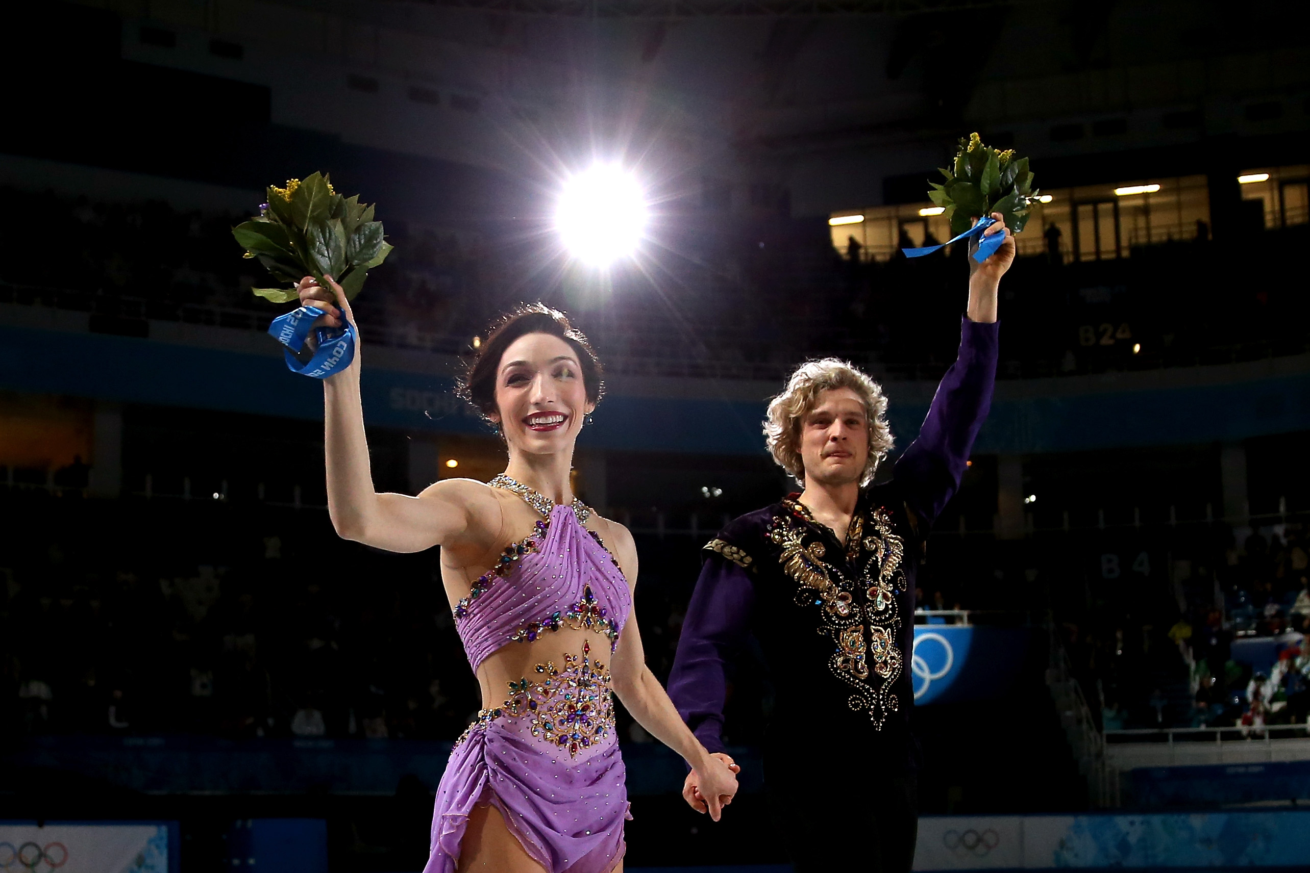 Meryl Davis and Charlie White of the U.S. celebrate in first place on the podium during the Figure Skating Ice Dance Free Dance Program.