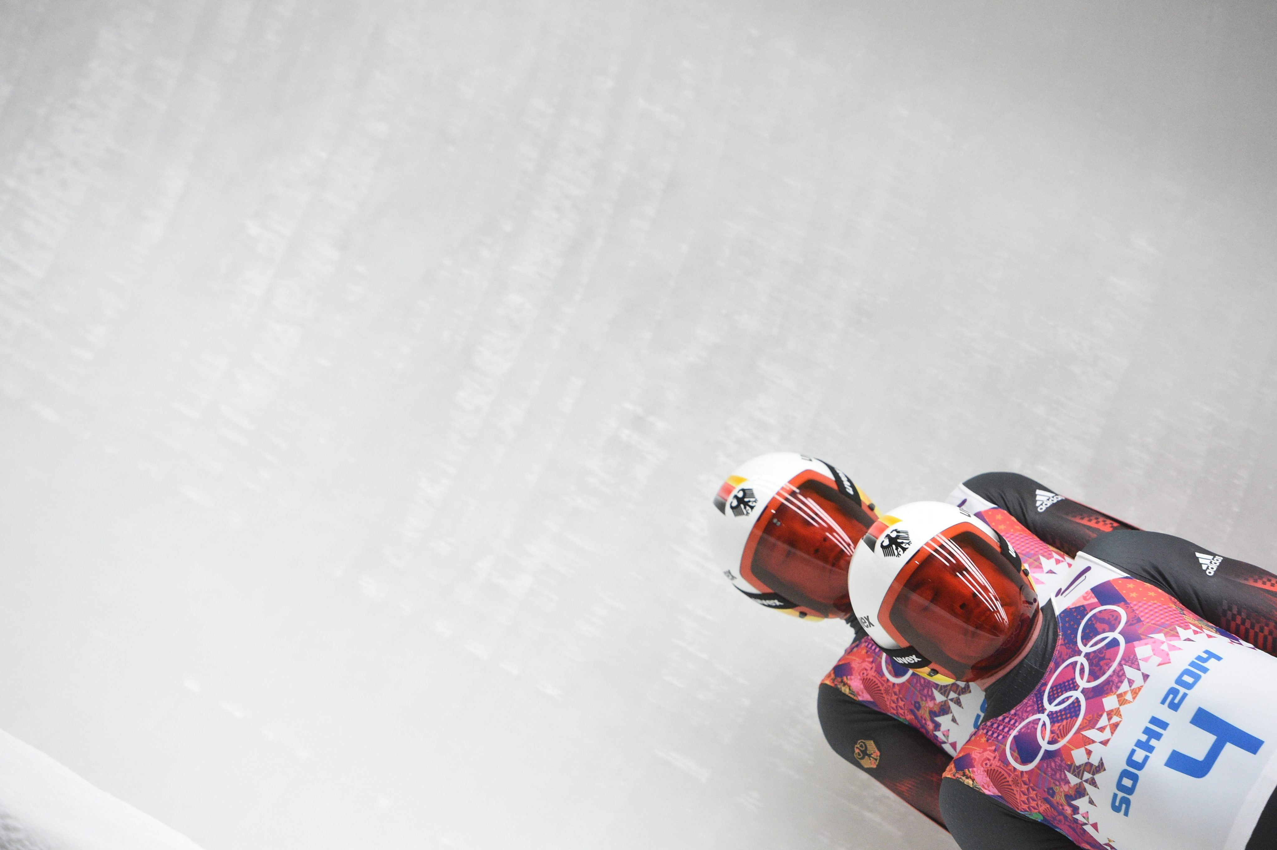 Tobias Wendl and Tobias Arlt of Germany during the first run of the Men's Doubles Luge competition at the Sochi 2014 Olympic Games.