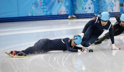 Sin Da-woon of South Korea, crashes as Lee Han-bin of South Korea goes down with him in a men's 1500m short track speedskating semifinal at the Iceberg Skating Palace during the 2014 Winter Olympics, Feb. 10, 2014, in Sochi.