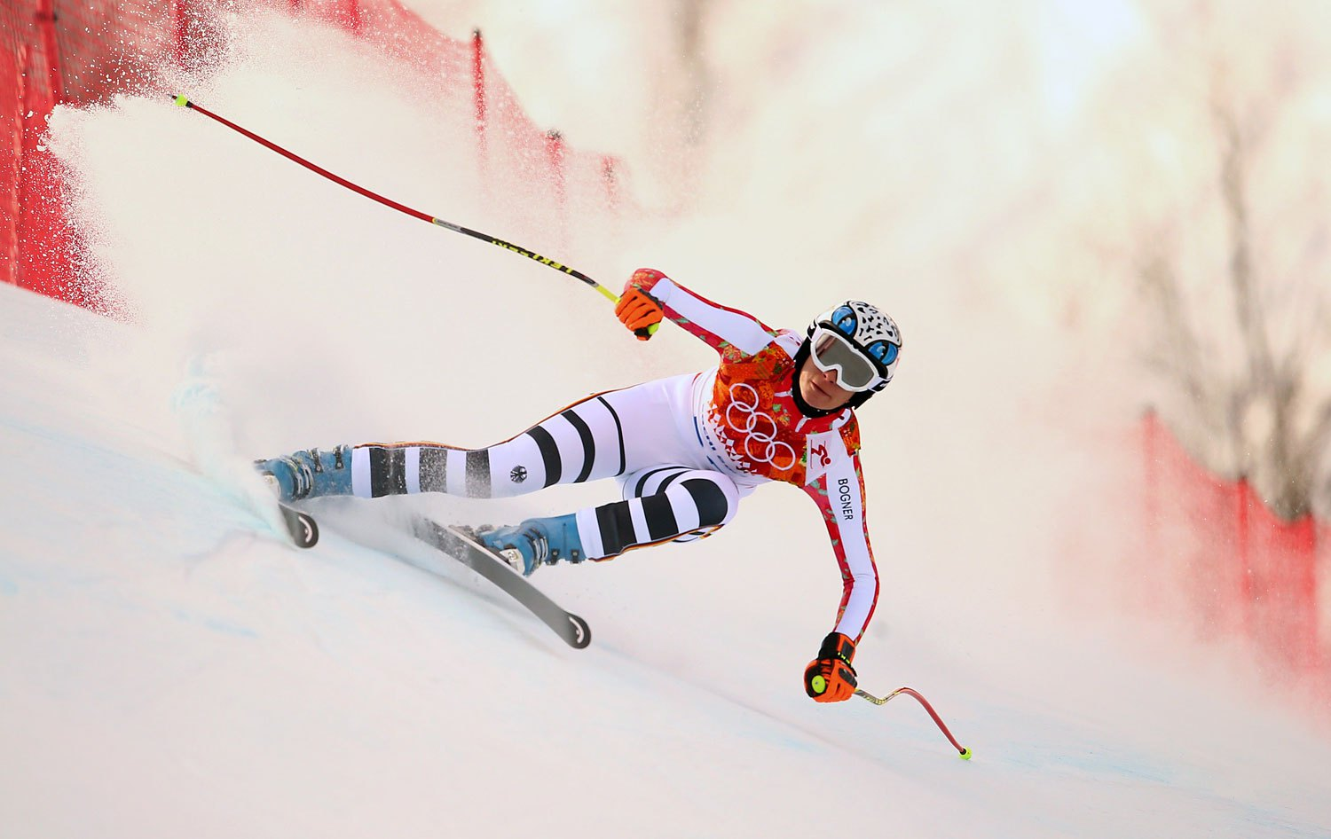 Maria Hoefl-Riesch of Germany competes in the Ladies' Super Combined Downhill in Rosa Khutor Alpine Center at the Sochi 2014 Olympic Games, Feb. 10, 2014.