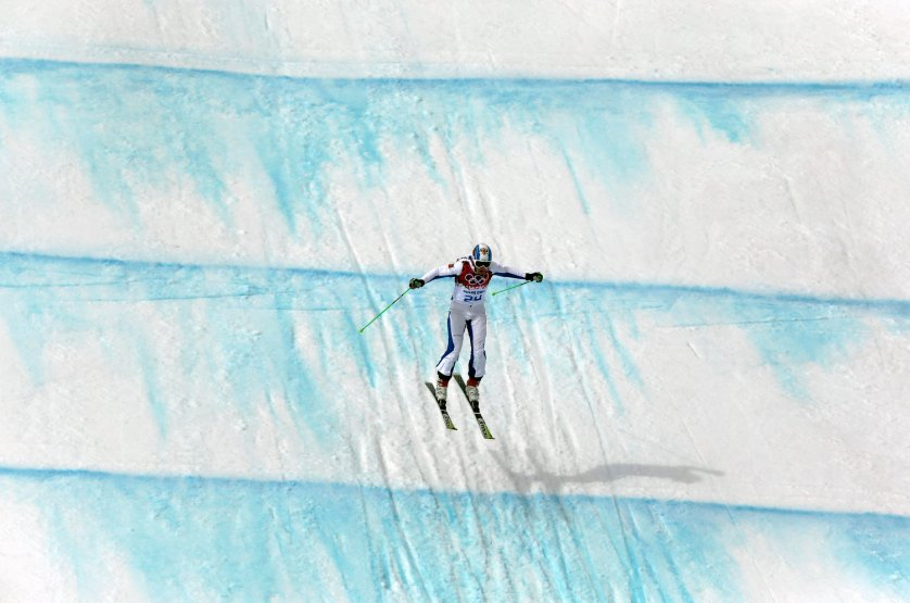 Russia's Igor Korotkov lands from a jump during men's ski cross seeding runs at the Rosa Khutor Extreme Park.