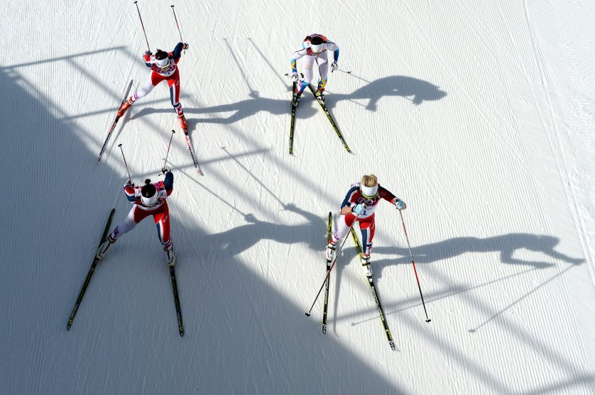 Norway's Therese Johaug, front right, competes with other athletes in the Women's Cross-Country Skiing 30km Mass Start Free.