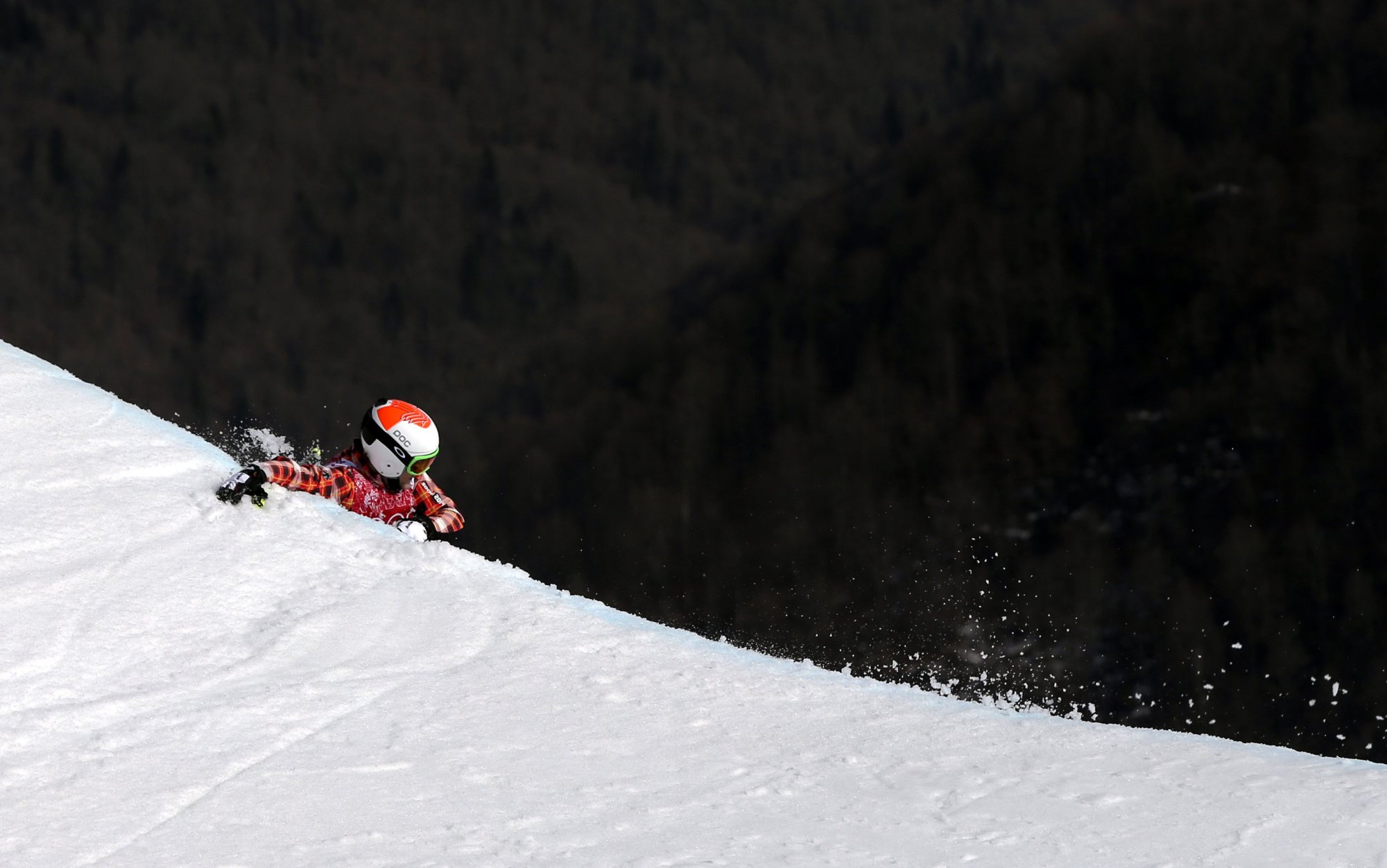Canada's Brady Leman falls off a jump after crashing in the men's ski cross final at the Rosa Khutor Extreme Park.