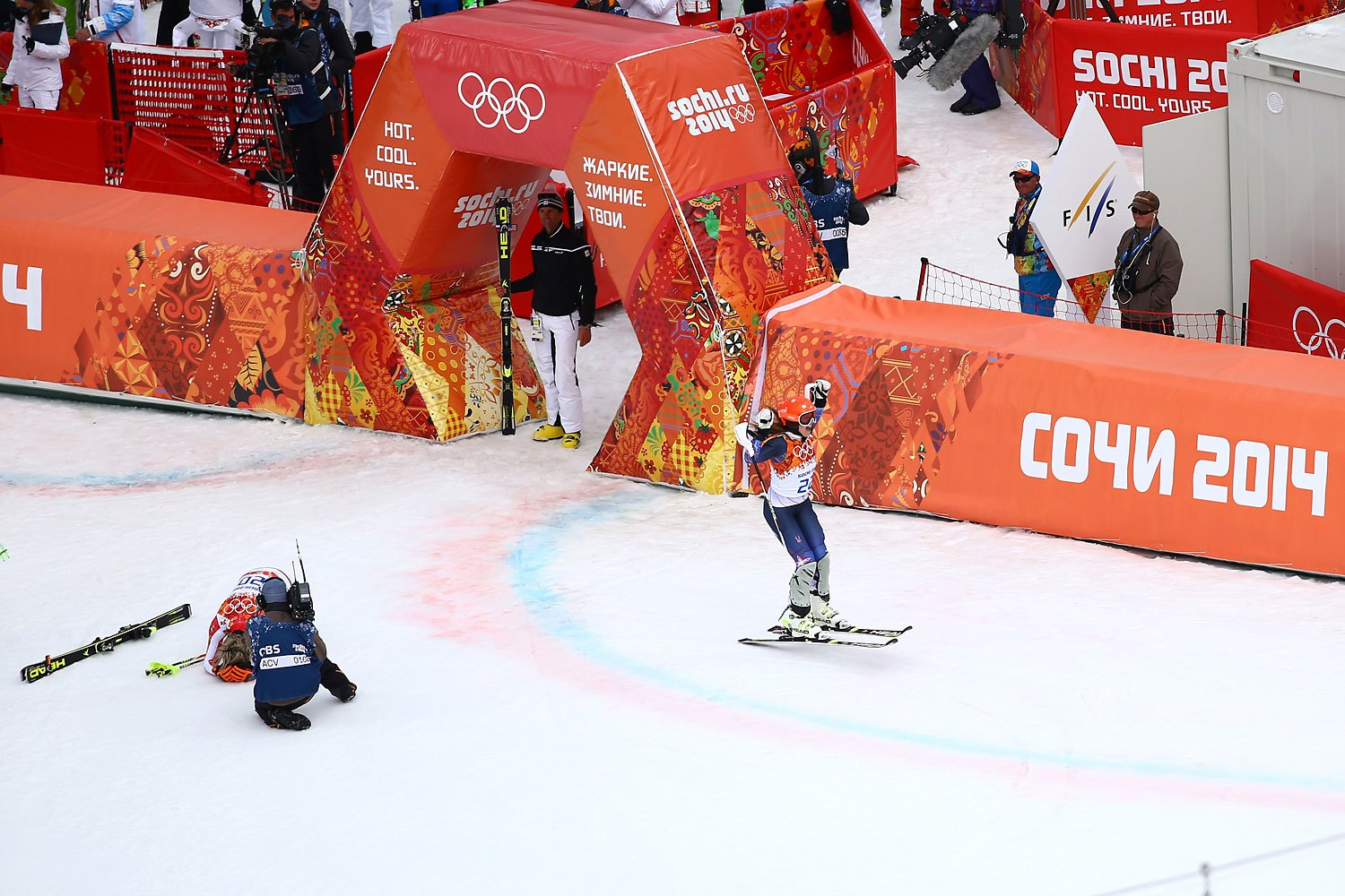 Gold medalist Maria Hoefl-Riesch of Germany reacts as Julia Mancuso of the United States wins the bronze medal during the Alpine Skiing Women's Super Combined Slalom on day 3 of the Sochi 2014 Winter Olympics at Rosa Khutor Alpine Center on Febr. 10, 2014 in Sochi.