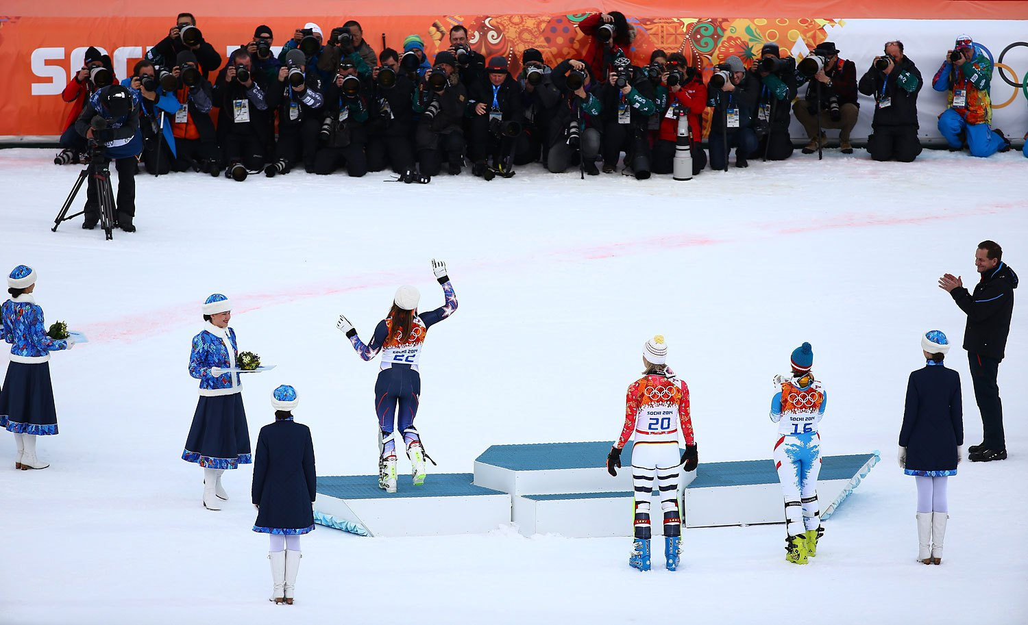 Silver medalist Nicole Hosp of Austria, gold medalist Maria Hoefl-Riesch of Germany and bronze medalist Julia Mancuso of the United States during the flower ceremony for the Alpine Skiing Women's Super Combined at Rosa Khutor Alpine Center on Feb. 10, 2014 in Sochi.