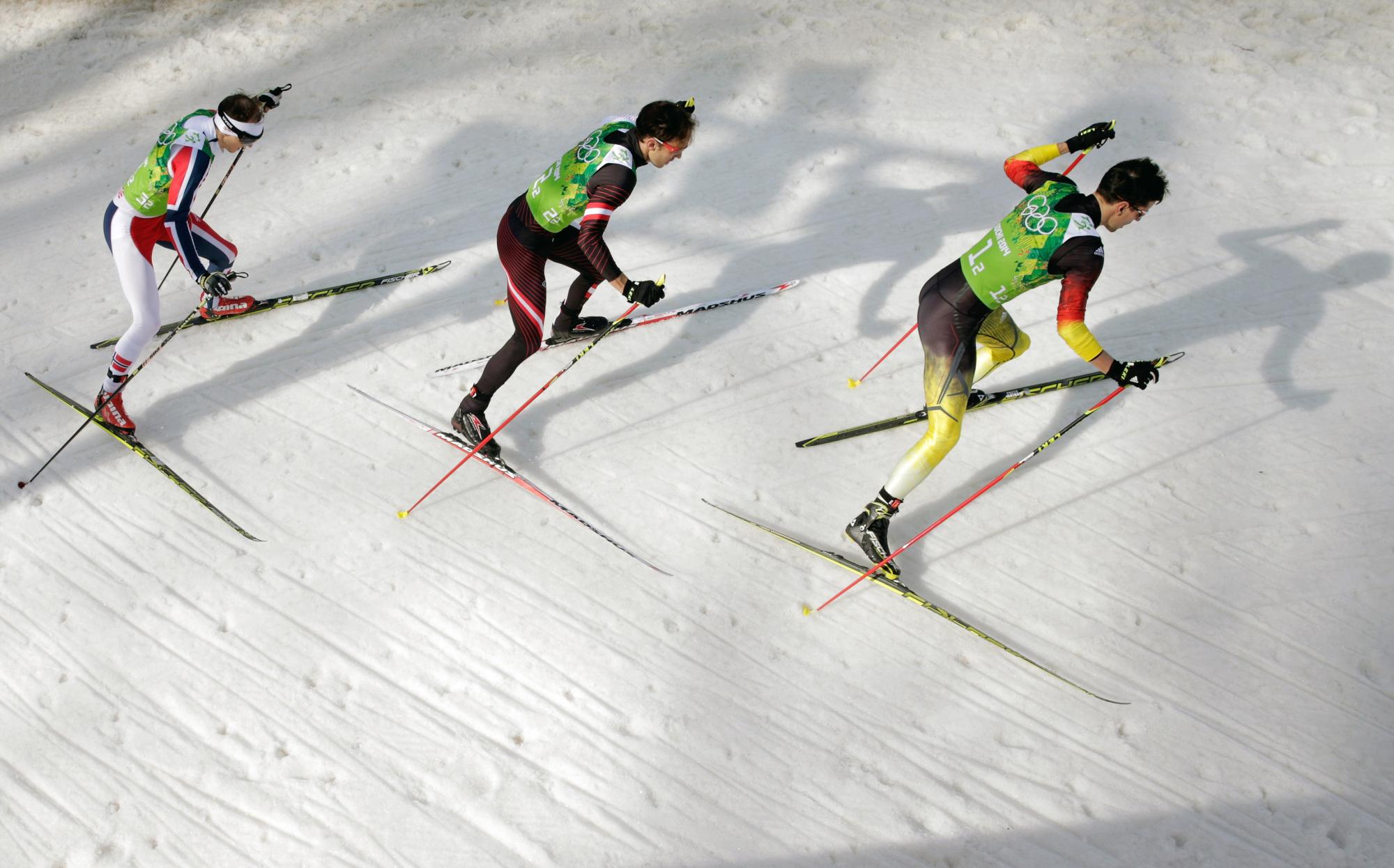 Haavard Klemetsen of Norway, Christoph Bieler of Austria and Bjoern Kircheisen of Germany compete in the Nordic Combined Men's Team 4 x 5 km.