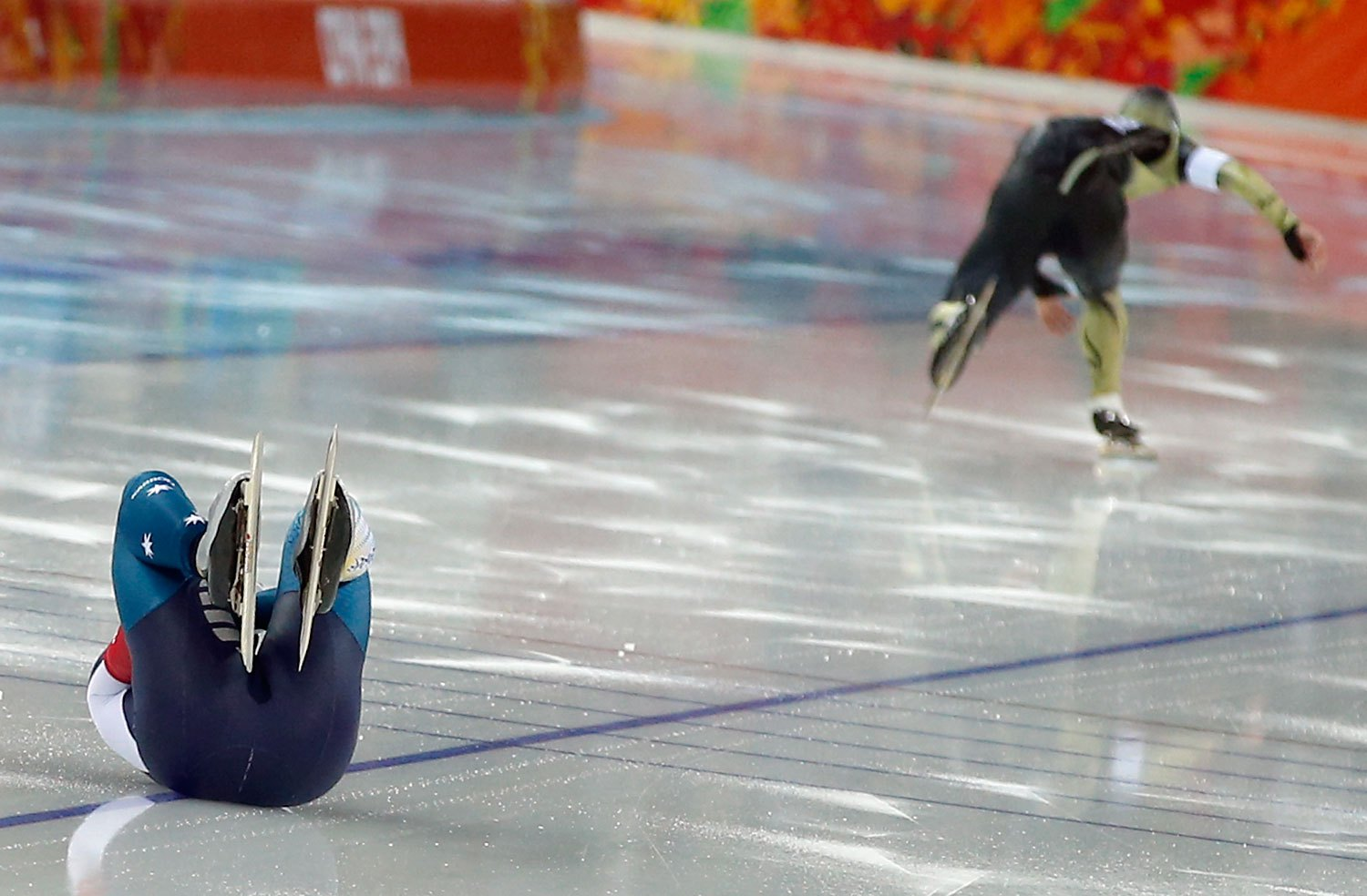 Australia's Daniel Greig, left, crashes in the first heat of his men's 500-meter speedskating race against Yuya Oikawa of Japan at the Adler Arena Skating Center at the 2014 Winter Olympics, Feb. 10, 2014, in Sochi.