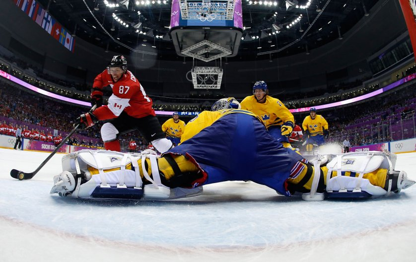 Canada's Sidney Crosby (87) scores on a breakaway past Sweden's goalie Henrik Lundqvist during the second period of their men's ice hockey gold medal game.