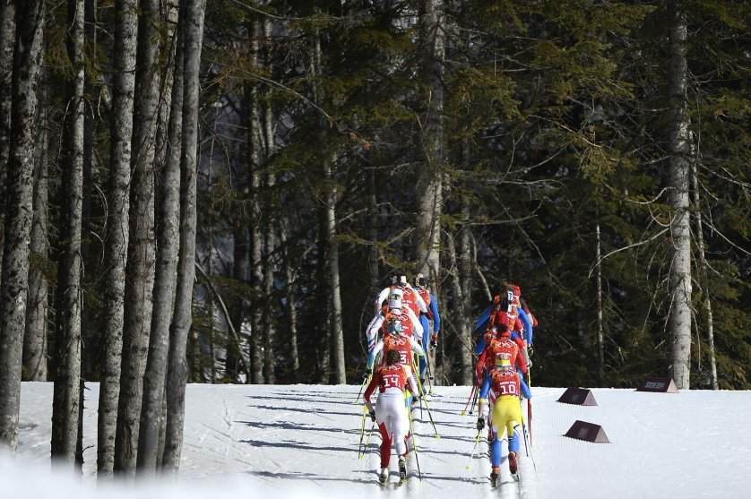 Athletes compete in the Women's Cross-Country Skiing 4x5km Relay at the Laura Cross-Country Ski and Biathlon Center during the Sochi Winter Olympics on February 15, 2014, in Rosa Khutor, near Sochi. AFP PHOTO / PIERRE-PHILIPPE MARCOU (Photo credit should read PIERRE-PHILIPPE MARCOU/AFP/Getty Images)