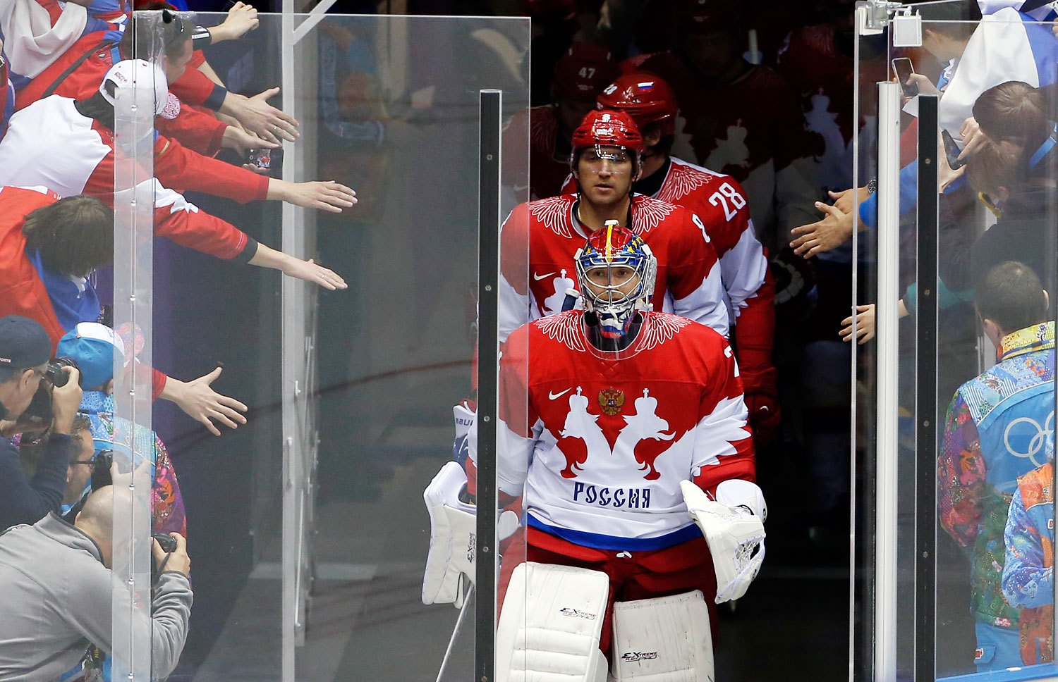Russia goaltender Semyon Varlamov and Russia forward Alexander Ovechkin lead the Russian team onto the ice for warmups before playing the USA.