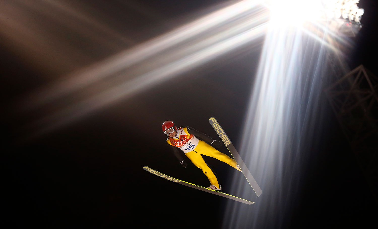Switzerland's Simon Ammann soars through the air during the first round of the men's ski jumping large hill individual final.
