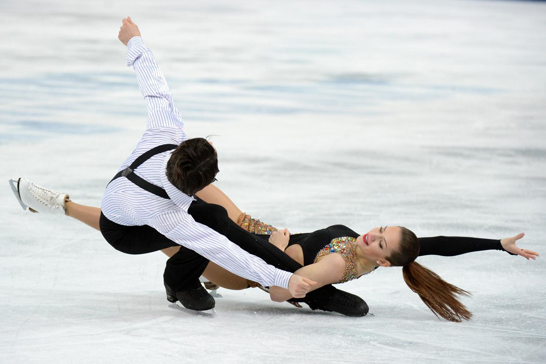 Turkey's Alisa Agafonova and Alper Ucar perform in the Figure Skating Ice Dance Short Dance at the Iceberg Skating Palace during the Sochi Winter Olympics on Feb. 16, 2014.