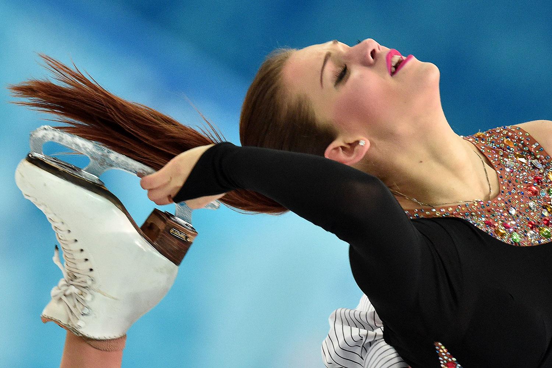 Turkey's Alisa Agafonova and Turkey's Alper Ucar (unseen) perform in the Figure Skating Ice Dance Short Dance.