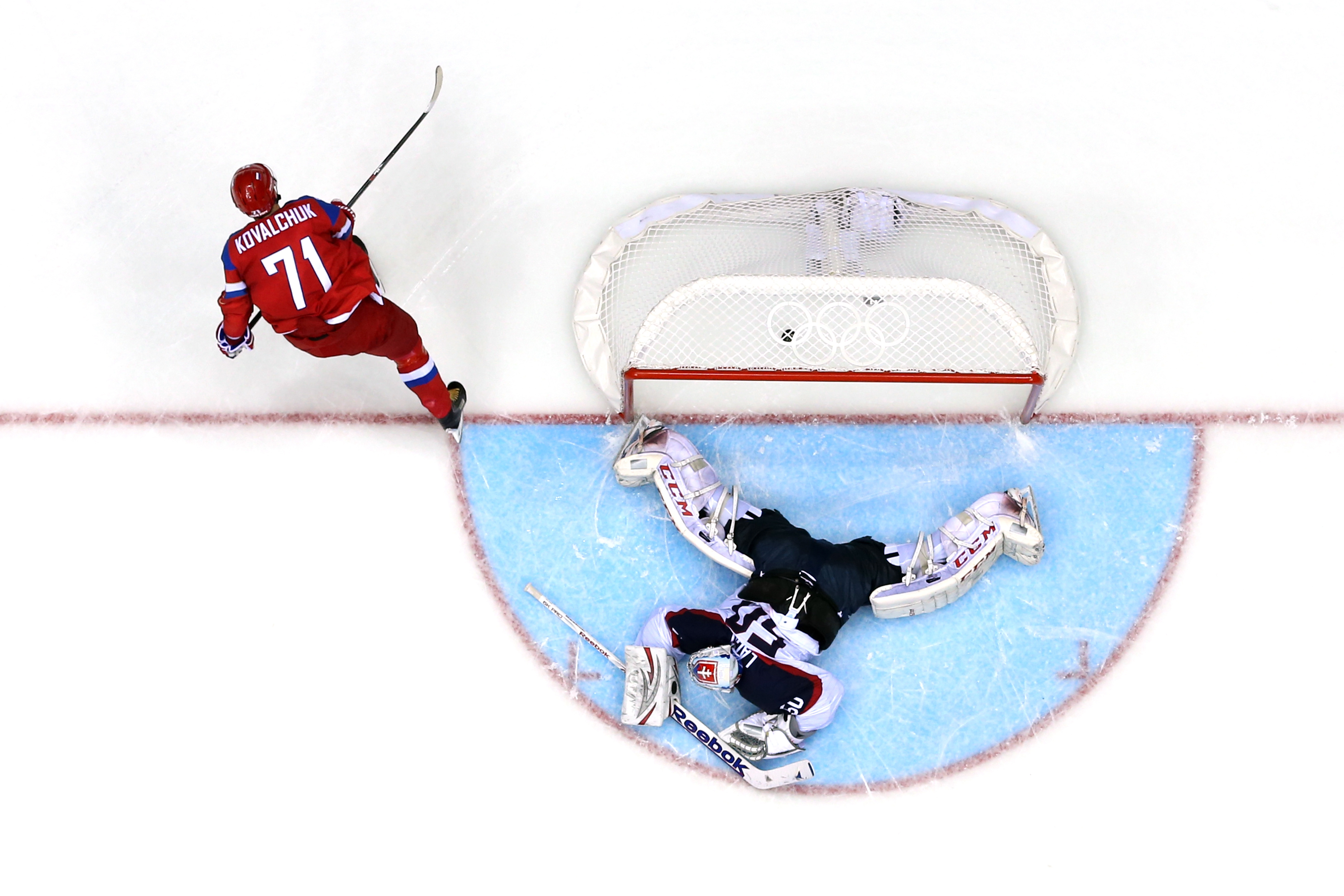 Ilya Kovalchuk #71 of Russia scores a winning goal in a shoot against Jan Laco #50 of Slovakia during the Men's Ice Hockey Preliminary Round Group A game during the Sochi 2014 Winter Olympics at Bolshoy Ice Dome on February 16, 2014 in Sochi, Russia.