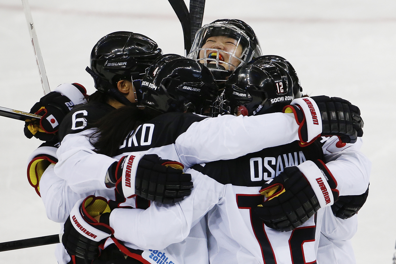 Team Japan celebrates their second goal against Russia during the 2014 Winter Olympics women's ice hockey game at Shayba Arena Sunday, Feb. 16, 2014, in Sochi, Russia.