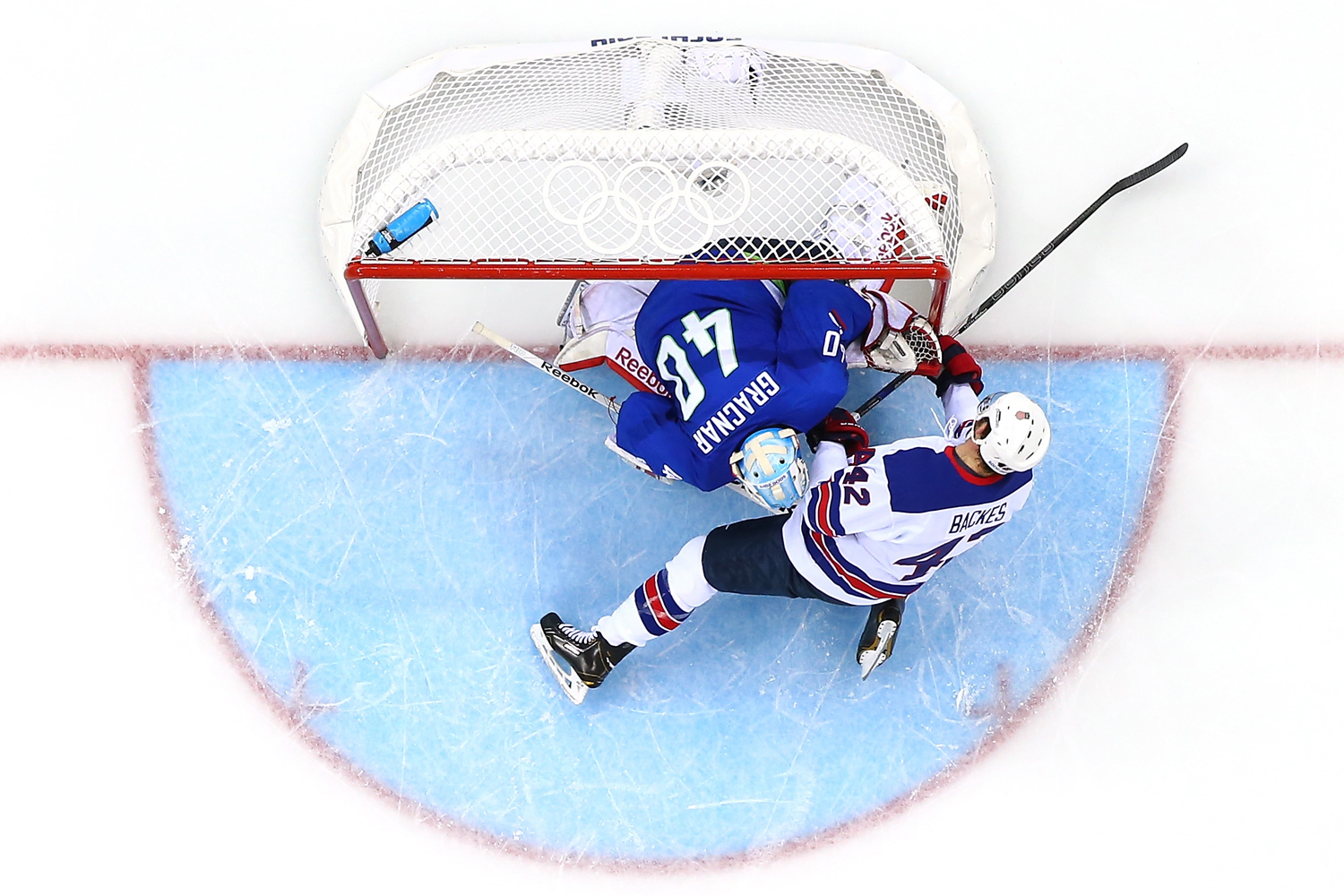 David Backes #42 of the United States collides with Luka Gracnar #40 of Slovenia in the second period during the Men's Ice Hockey Preliminary Round Group A game during the Sochi 2014 Winter Olympics at Shayba Arena on February 16, 2014 in Sochi, Russia.