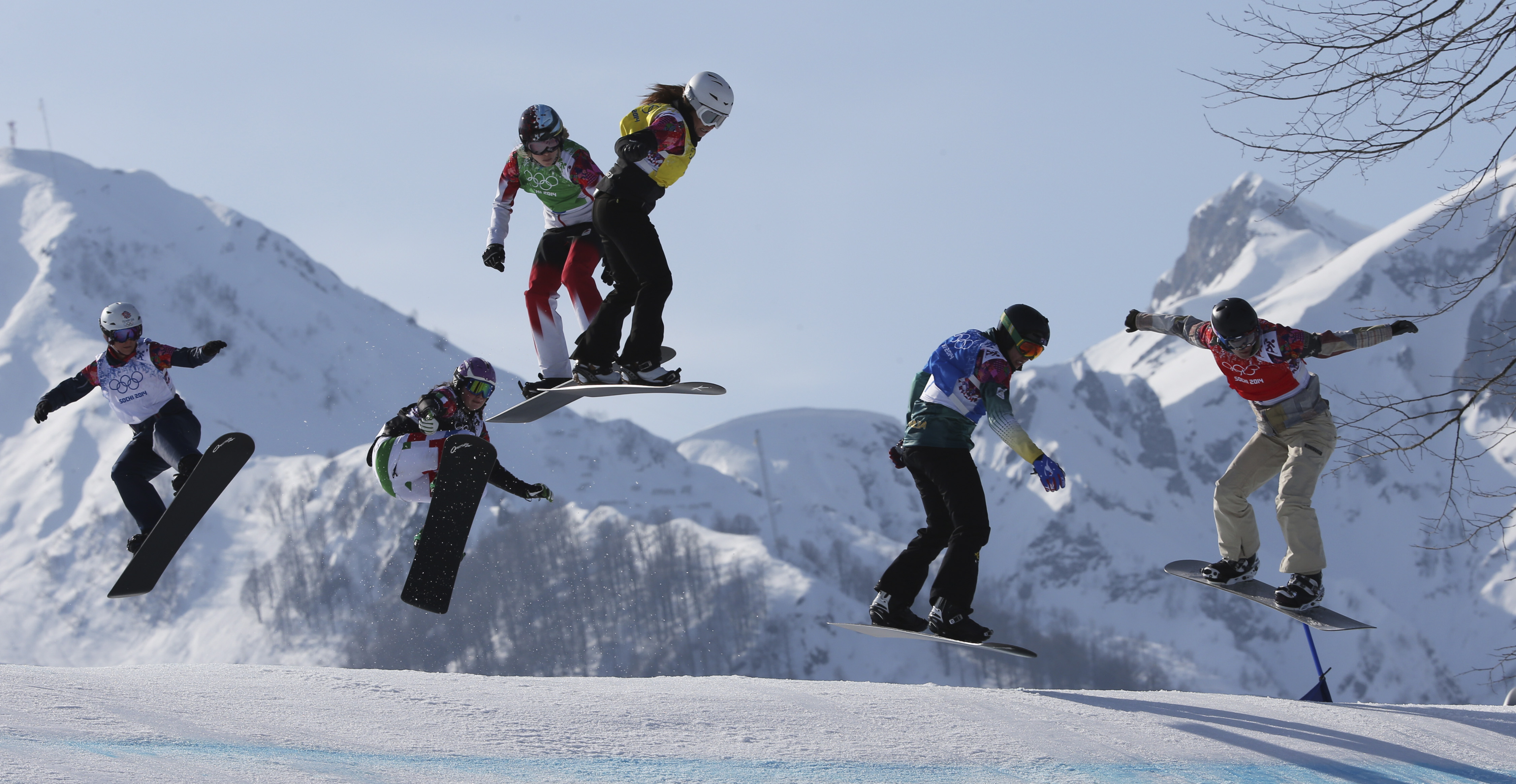 Lindsey Jacobellis, right,  of the United States leads during the women's snowboard cross semifinal at the Rosa Khutor Extreme Park, at the 2014 Winter Olympics, Sunday, Feb. 16, 2014, in Krasnaya Polyana, Russia. The other riders are, from left, Britain's Zoe Gillings, Italy's Michela Moioli, Canada's Dominique Maltais, Bulgaria's Alexandra Jekova, and Australia's Belle Brockhoff.