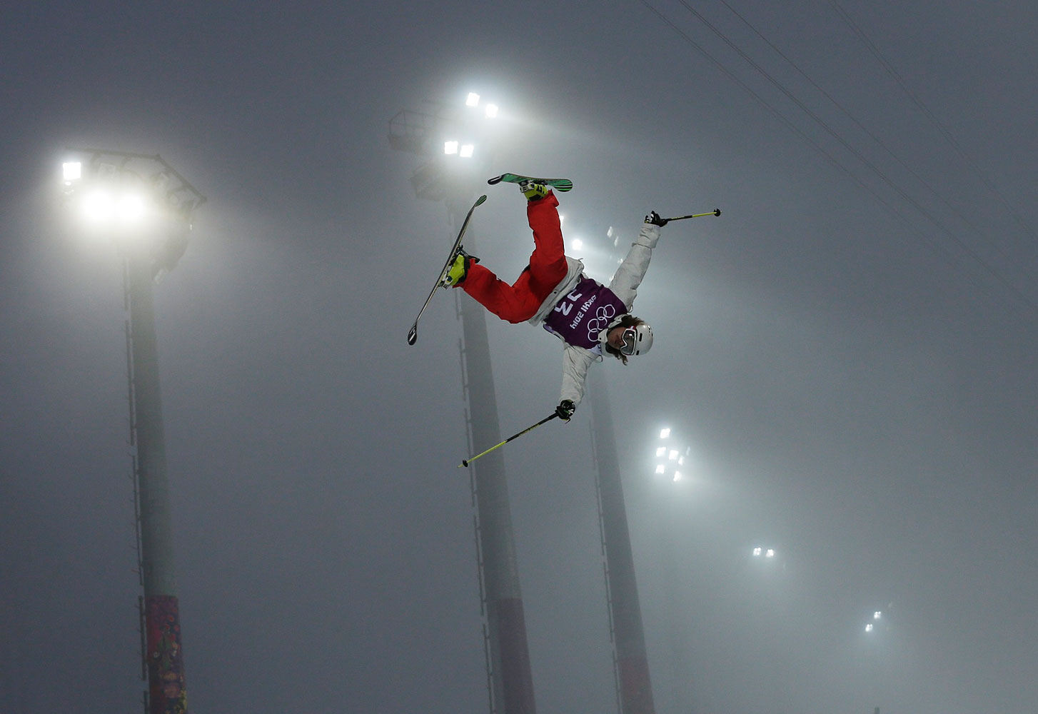 Switzerland's Nils Lauper gets air during men's freestyle skiing half pipe training.