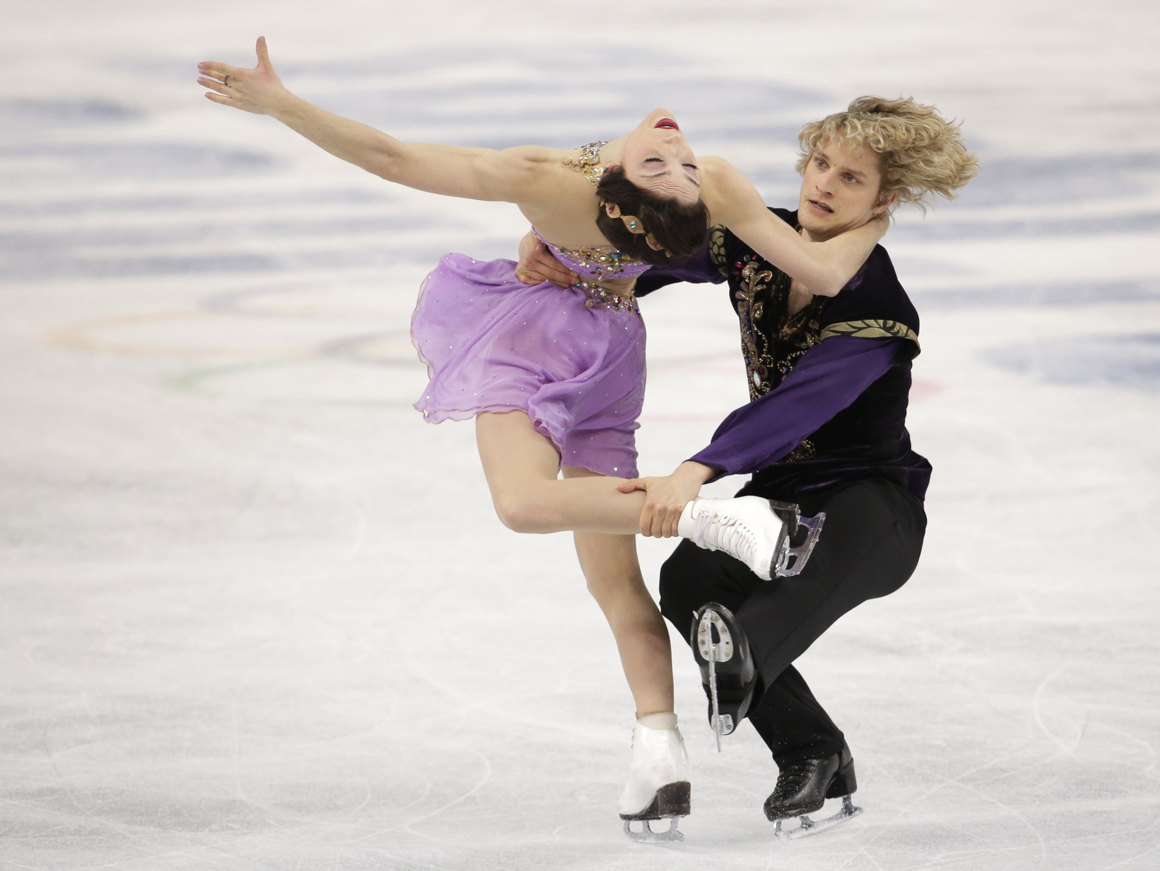 Meryl Davis and Charlie White of the United States compete in the ice dance free dance figure skating finals at the Iceberg Skating Palace.