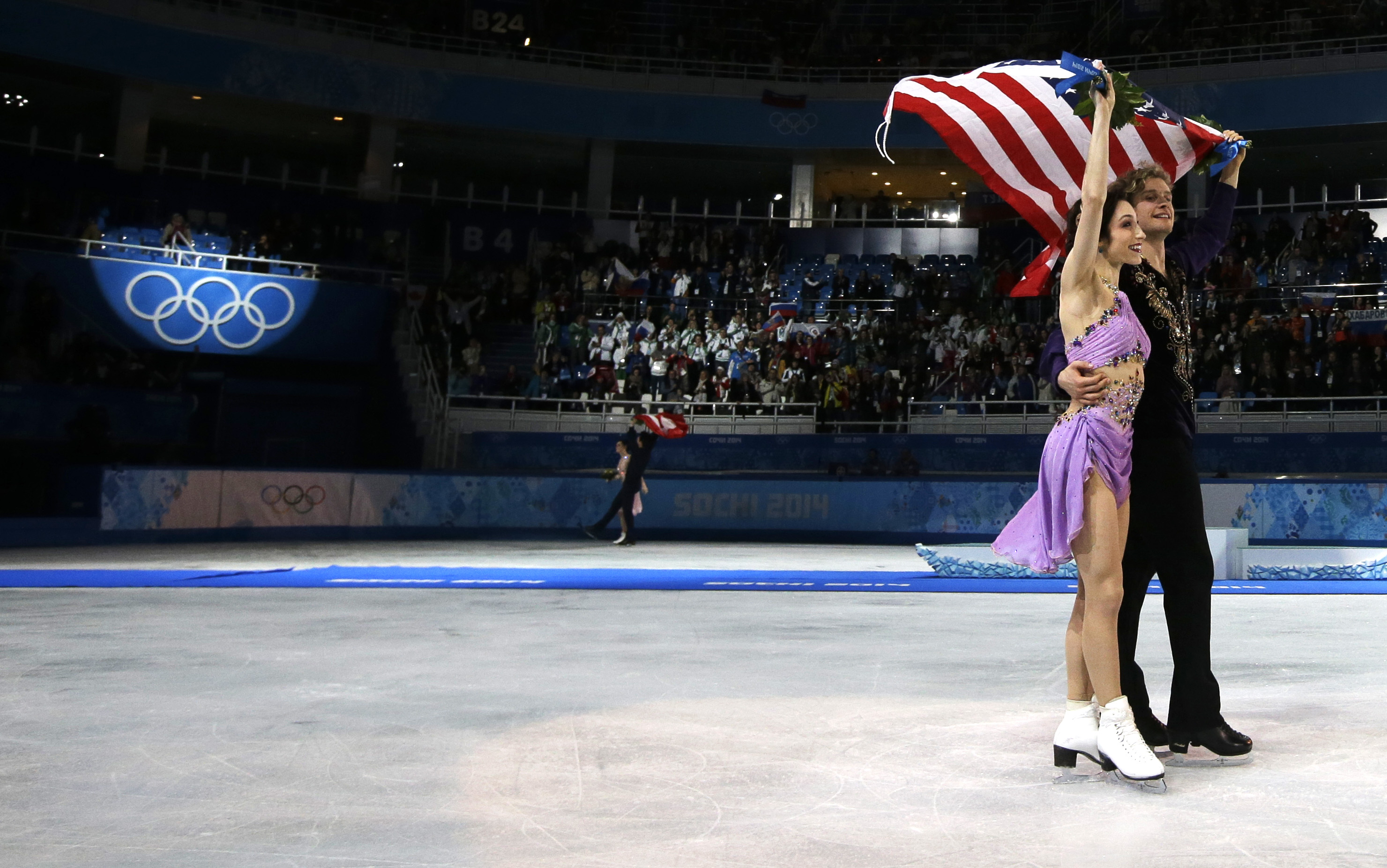 Meryl Davis and Charlie White of the United States celebrate their first place following the flower ceremony in the ice dance free dance figure skating finals.
