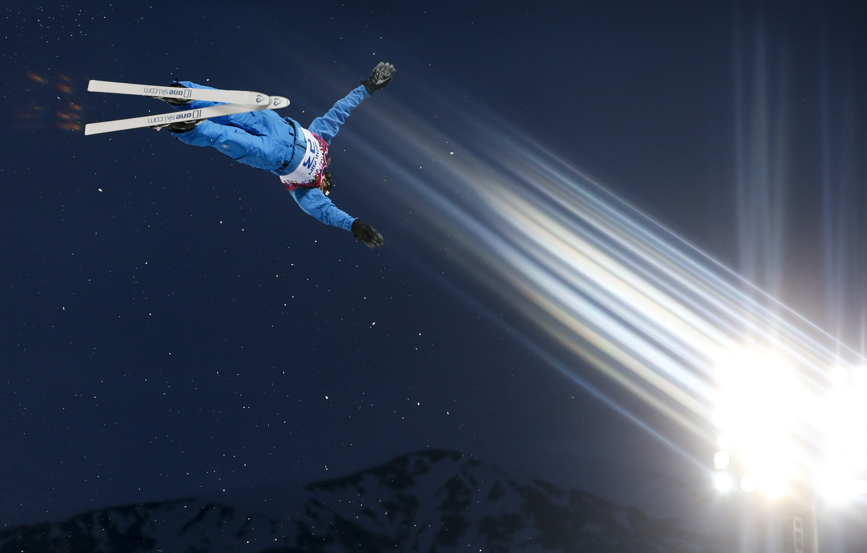 Belarus' Denis Osipau performs a jump during the men's freestyle skiing aerials qualification round.