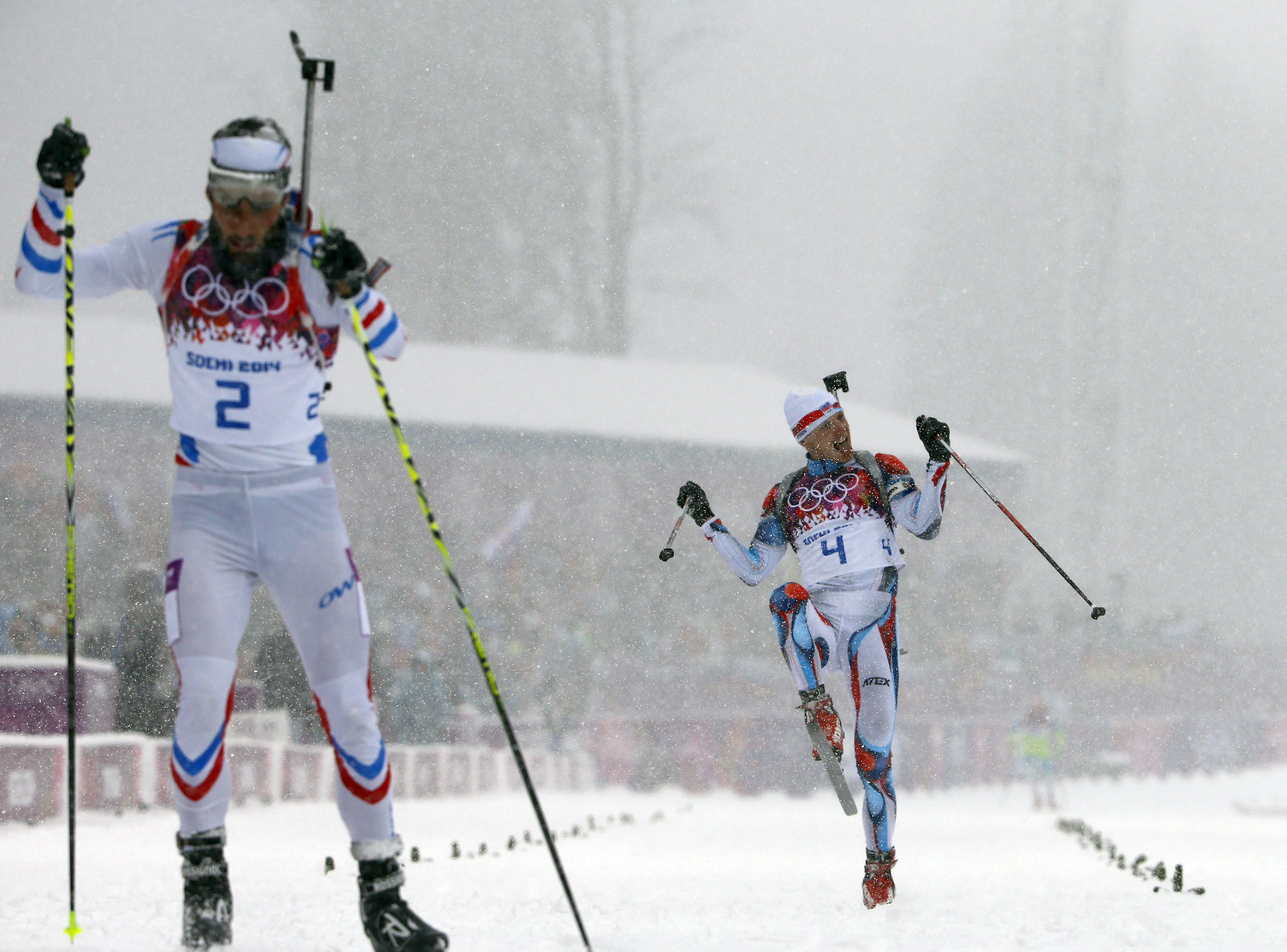 Czech Republic's Ondrej Moravec (R) reacts after crossing the finish line next to France's Martin Fourcade during the men's biathlon 15km mass start event.