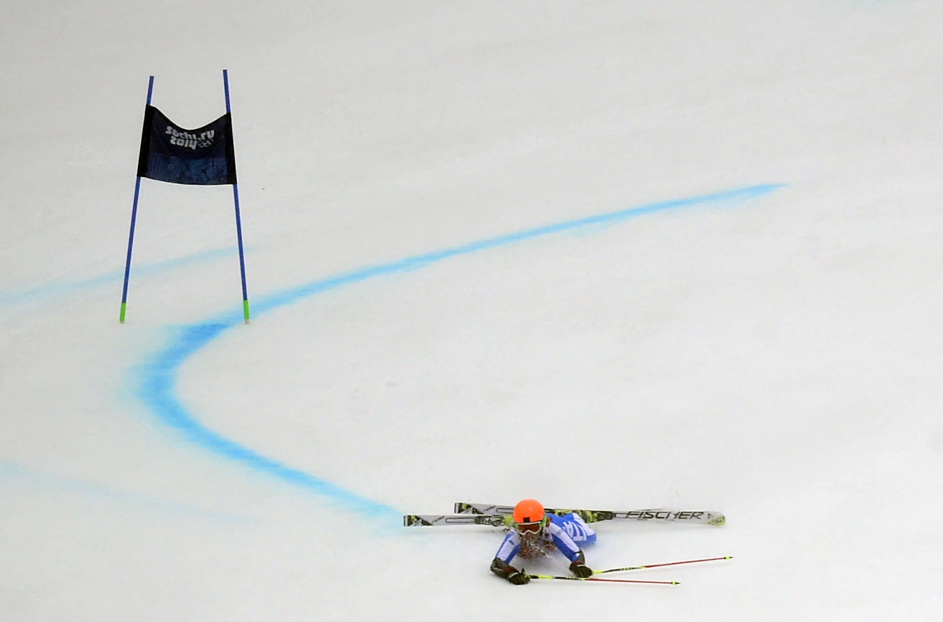 Italy's Denise Karbon lies on the slope after falling during the Women's Alpine Skiing Giant Slalom Run 2 at the Rosa Khutor Alpine Center.