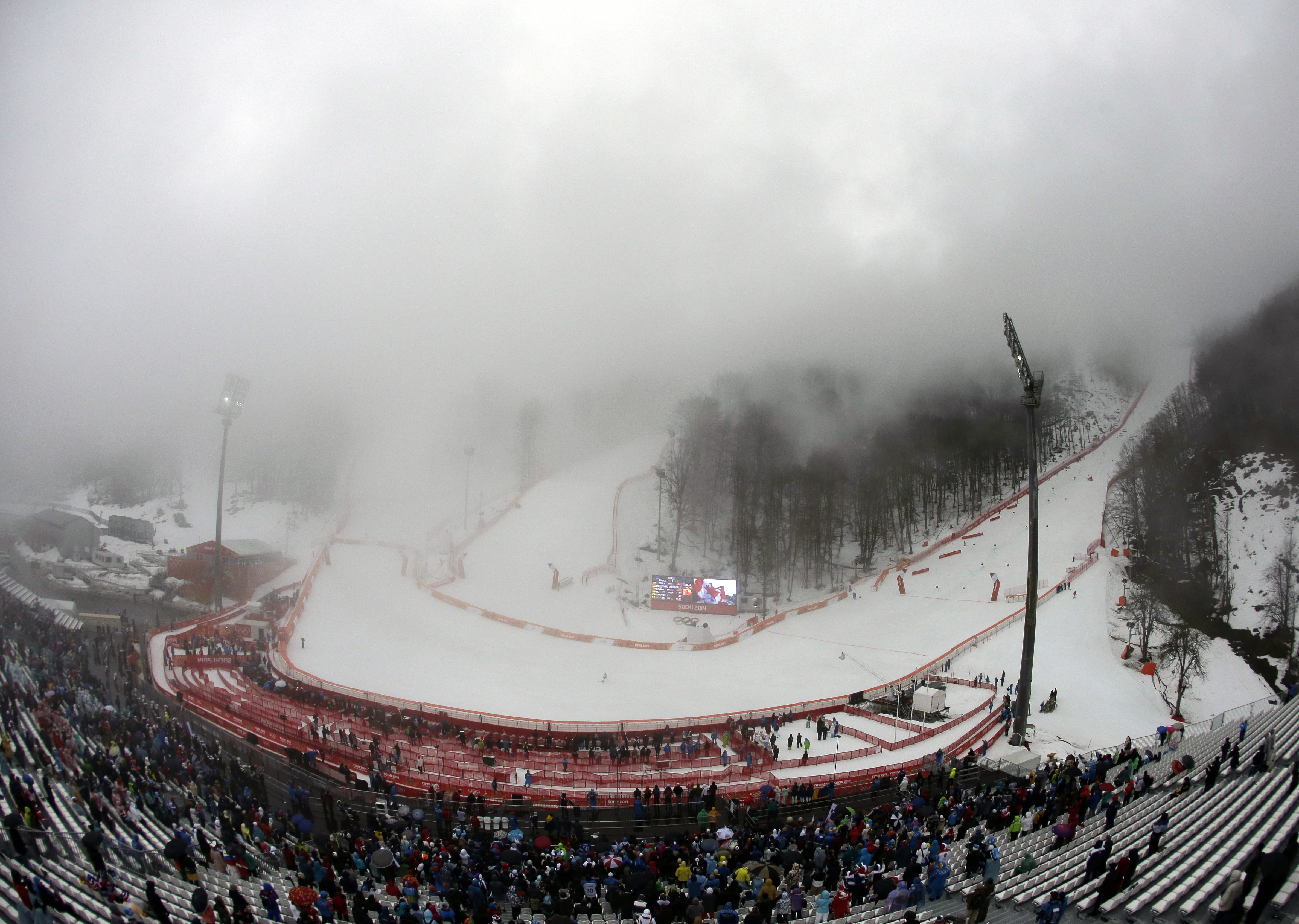 Fog blankets the finish area of the Alpine ski course during the second run in the women's giant slalom.