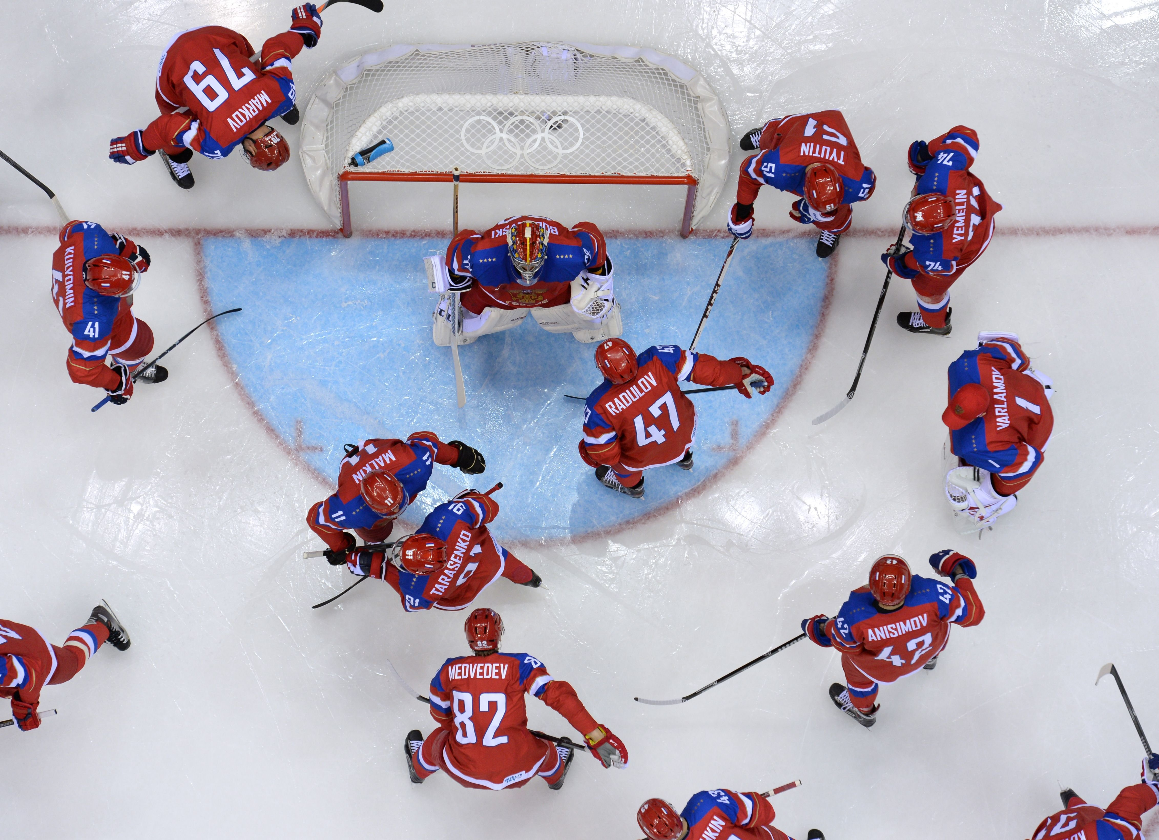Russia's players gather before the start of the Men's Ice Hockey play-offs qualification match Russia vs Norway at the Bolshoy Ice Dome.