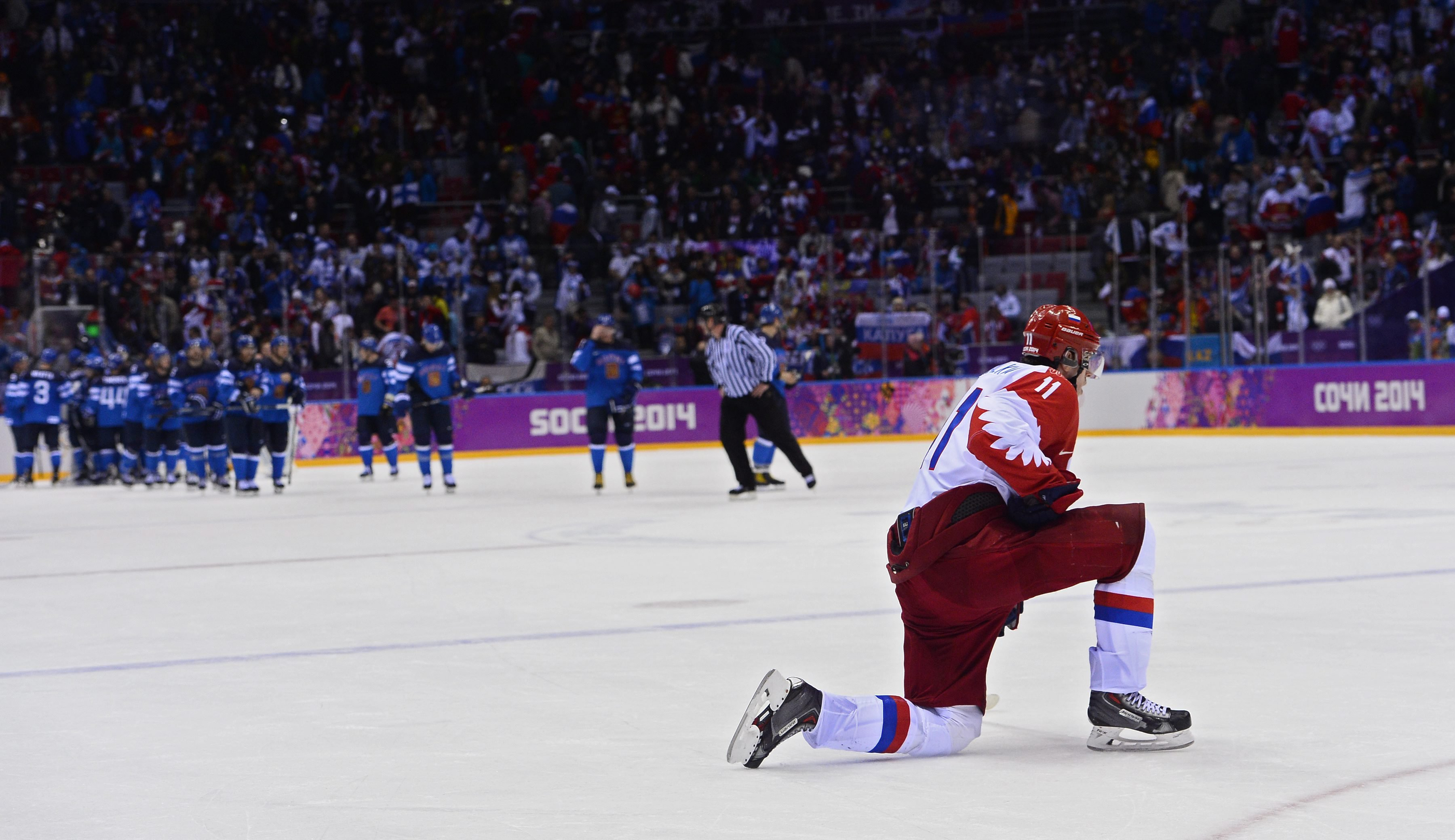 Yevgeni Malkin of Russia kneels on the ice after losing to Finland in the quarter final match between Finland and Russia.