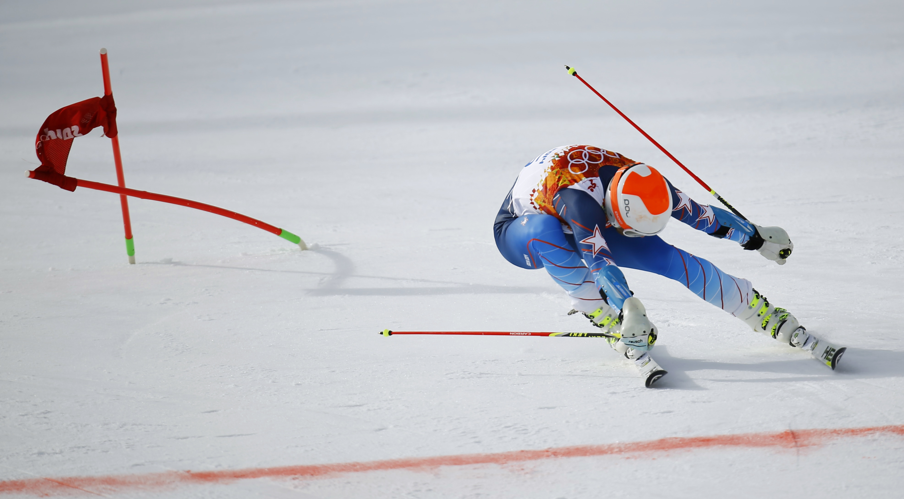 Bode Miller of the U.S. lunges towards the finish line during the first run of the men's alpine skiing giant slalom event.