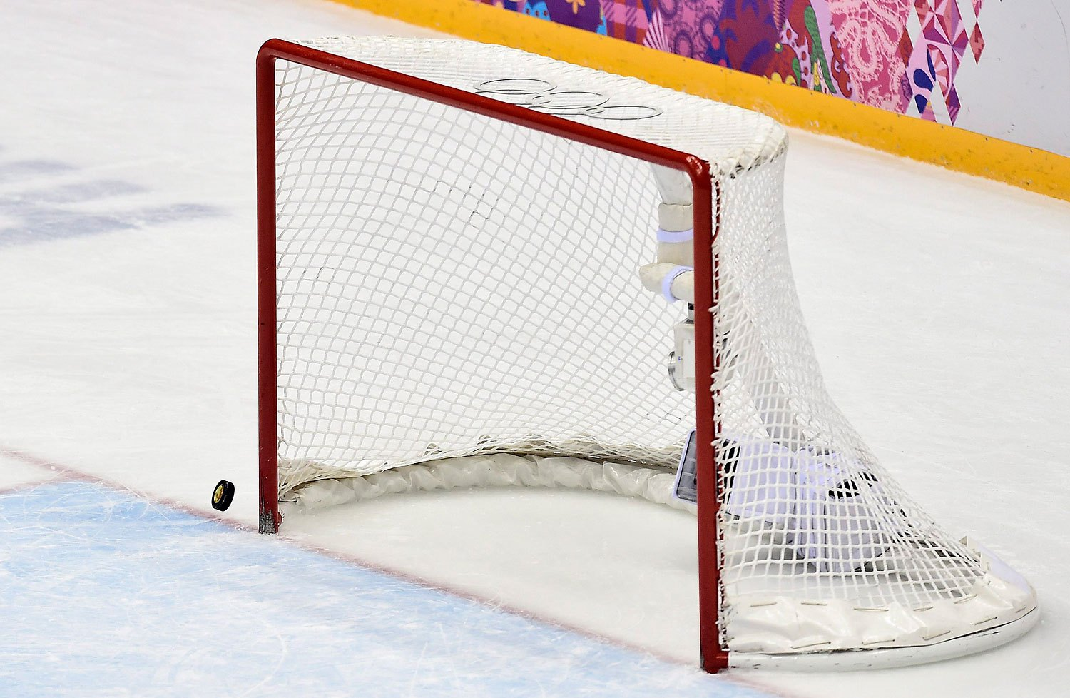 The puck hits the post with Canada's goalie pulled in the last minutes of the third period of the gold-medal women's hockey game between Canada and the United States,