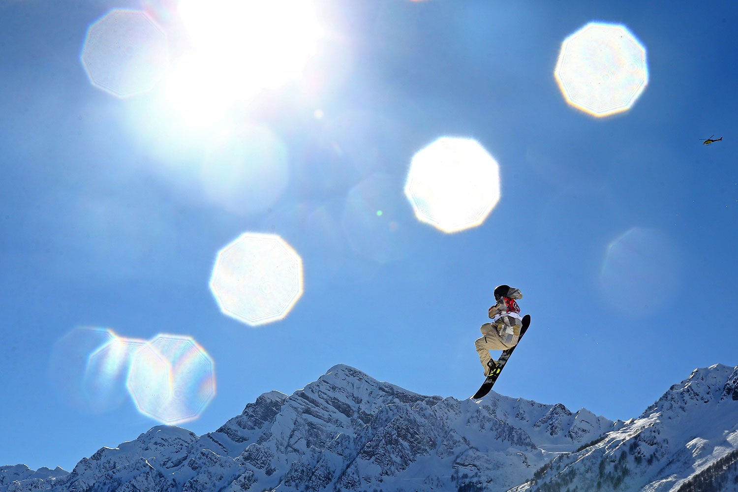 Sage Kotsenburg of the United States competes in the Snowboard Men's Slopestyle Final during day 1 of the Sochi 2014 Winter Olympics Feb. 8, 2014.