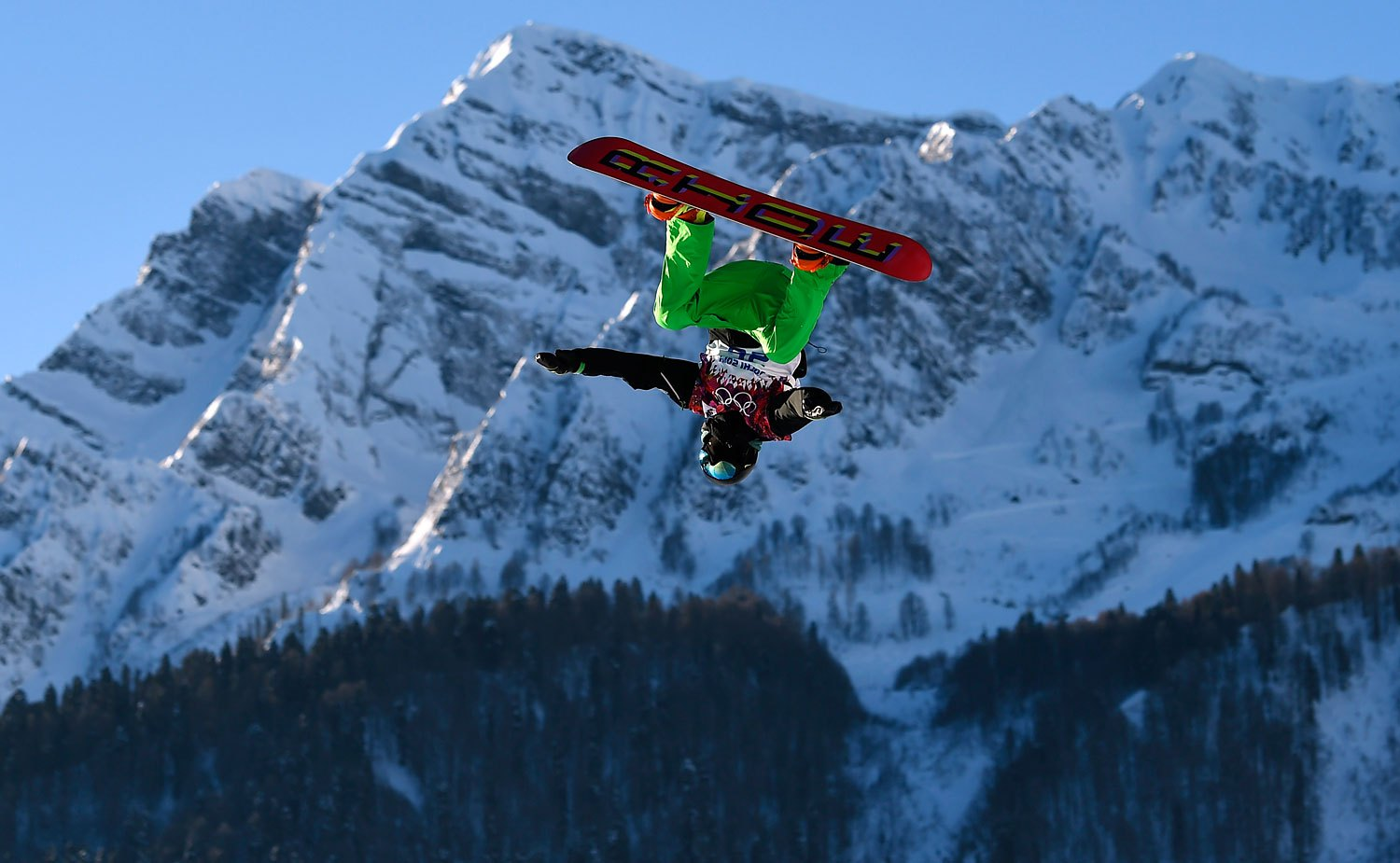 Ireland's Seamus O'Connor performs a jump during the men's snowboard slopestyle semi-final competition in Rosa Khutor, Feb. 8, 2014.
