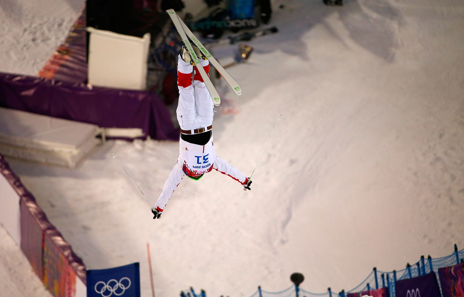 China's Qin Ning performs a jump during the women's freestyle skiing moguls qualification round in Rosa Khutor, Feb. 8, 2014.