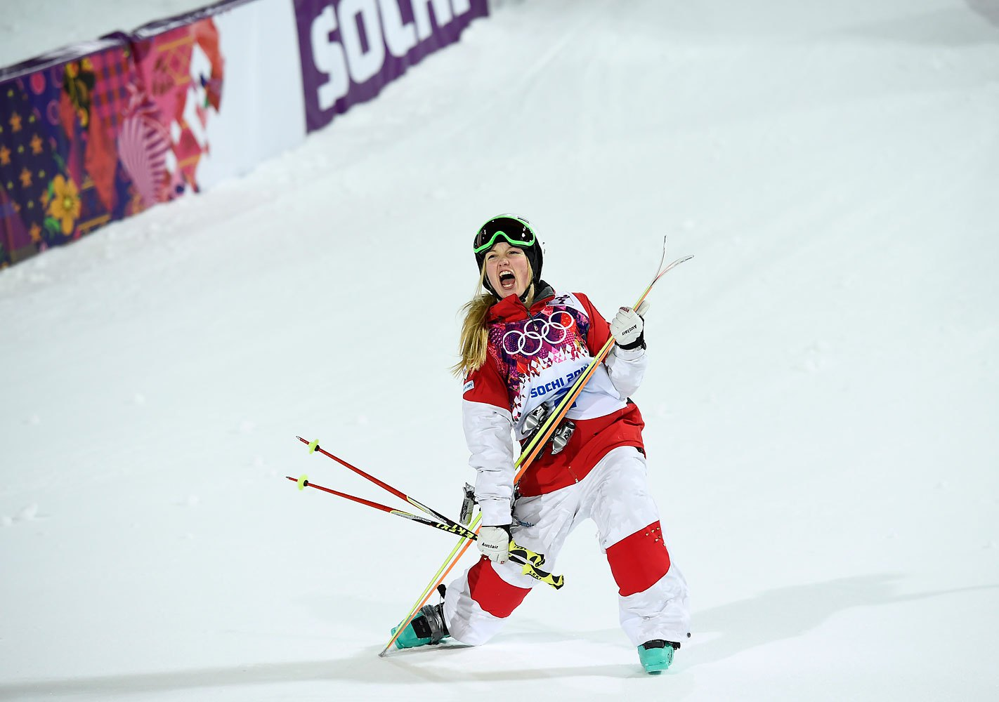 Canada's Justine Dufour-Lapointe celebrates after winning the women's freestyle skiing moguls final competition,  Feb. 8, 2014.