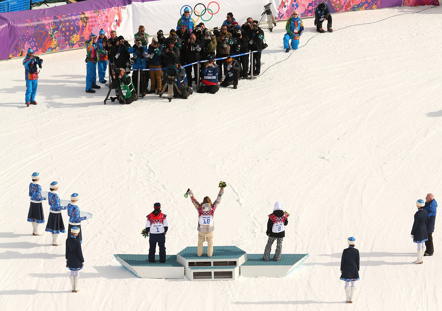 Left to right, bronze medalist Jenny Jones of Great Britain, gold medalist Jamie Anderson of the United States and silver medalist Enni Rukajarvi of Finland celebrate during the flower ceremony for the Women's Snowboard Slopestyle Finals at Rosa Khutor Extreme Park on Feb. 9, 2014.