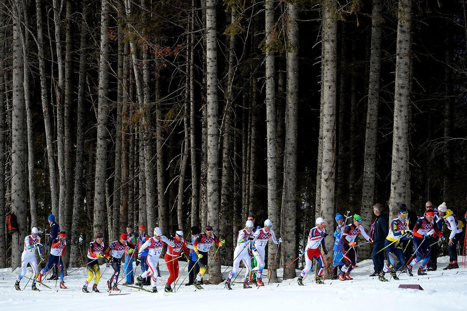 Skiers compete in the Men's Skiathlon 15 km Classic + 15 km Free during day two of the Sochi 2014 Winter Olympics at Laura Cross-country Ski & Biathlon Center on Feb. 9 2014.