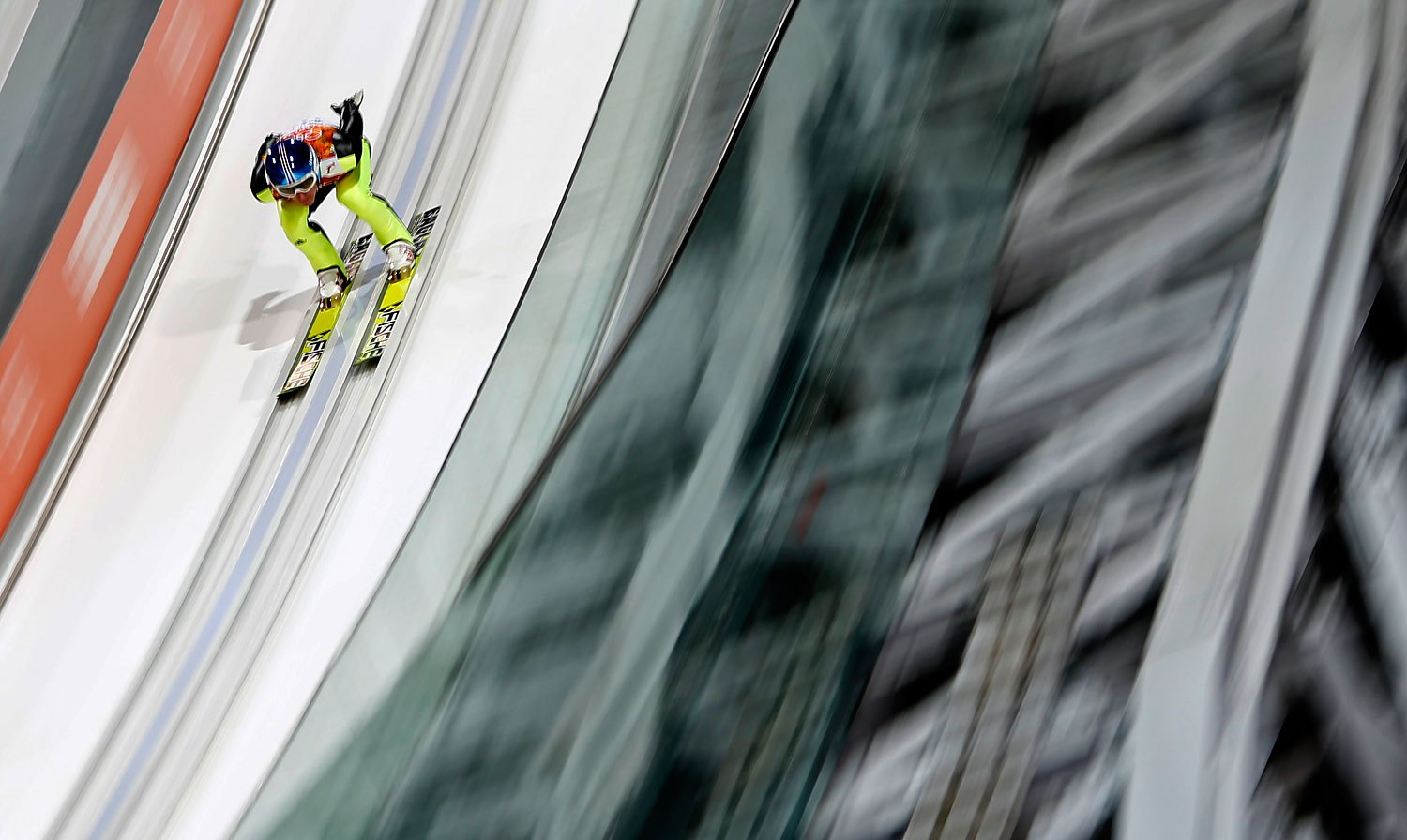 Germany's Severin Freund speeds down the ski jump in his trial jump of the men's ski jumping normal hill individual final event at the RusSki Gorki Ski Jumping Center in Rosa Khutor, Feb. 9, 2014.