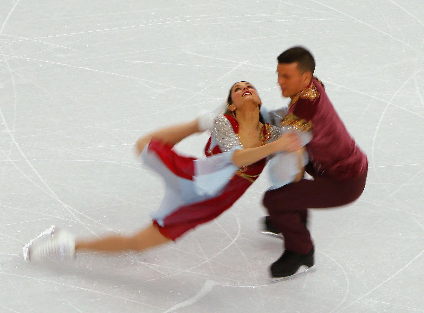 Charlene Guignard, left, and Marco Fabbri of Italy compete during the figure skating team ice dance free dance, Feb. 9, 2014.