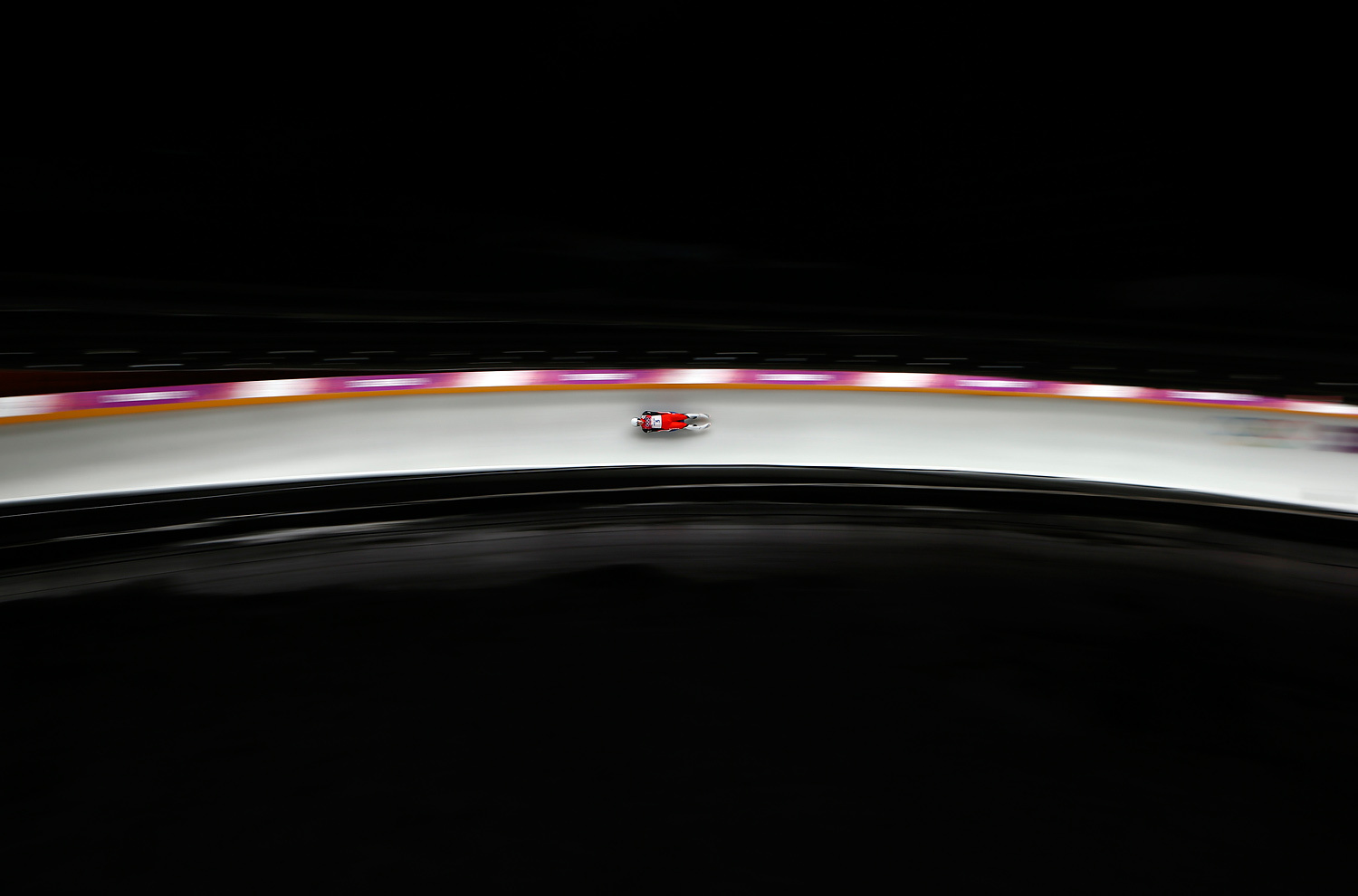 Austria's Reinhard Egger speeds down the track in the men's singles luge competition at the 2014 Sochi Winter Olympics February 9, 2014.