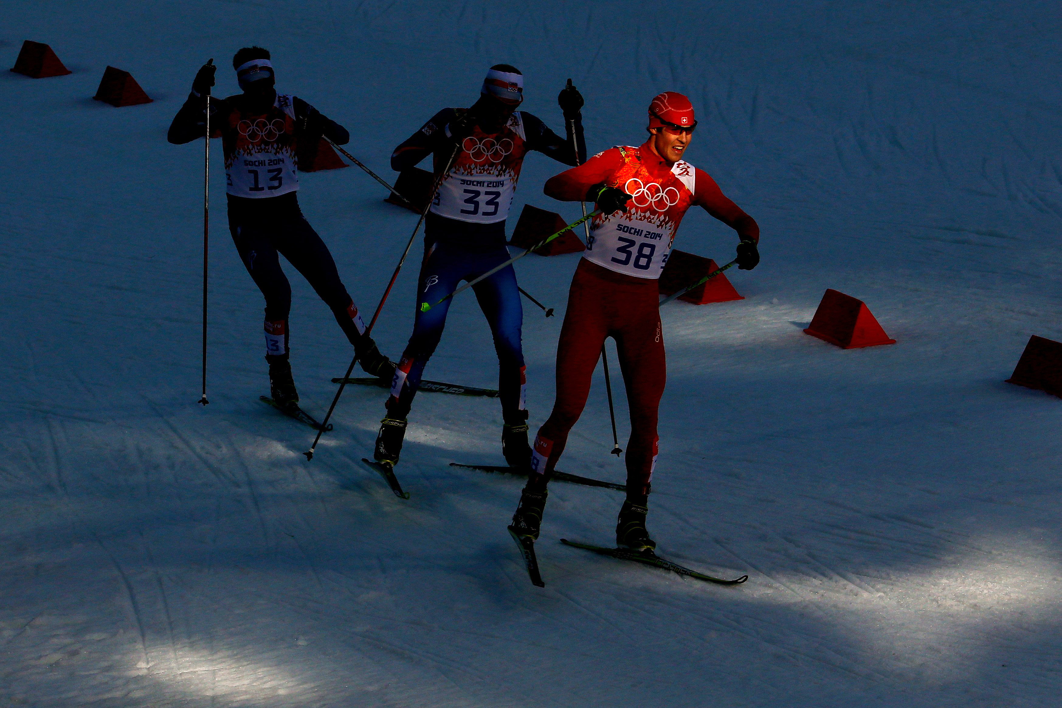 Tomas Portyk of the Czech Republic, Tomas Slavik of Czech Republic and Tim Hug of Switzerland in action during the Nordic Combined Individual Gundersen Normal Hill and 10km Cross Country.